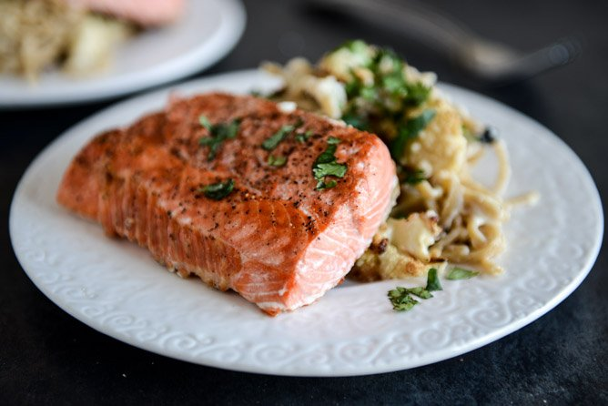Broiled Salmon and Roasted Garlic Cream Noodles with Crispy Cauliflower + Toasted Pine Nuts I howsweeteats.com