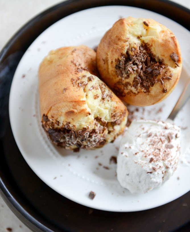 Dark Chocolate Chunk Popovers with Spiked Vanilla Bourbon Whipped Cream I howsweeteats.com