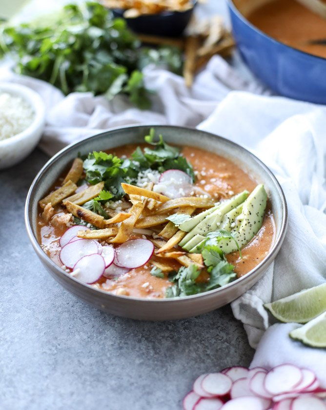 cheesy turkey (or chicken!!) tortilla soup with crispy tortilla strips I howsweeteats.com