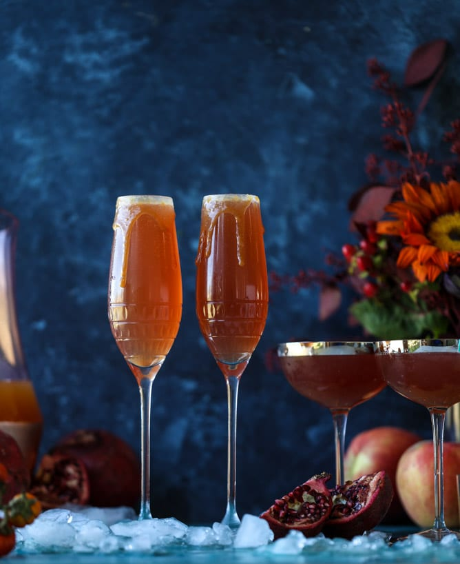 pomegranate cider mimosas with a salted caramel rim I howsweeteats.com #cocktails #thanksgiving #applecider #mimosas