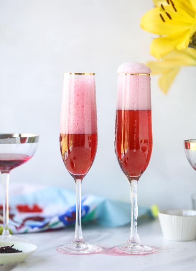 rosé hibiscus mimosas I howsweeteats.com #champagne #mimosa #rose #hibiscus #cocktail