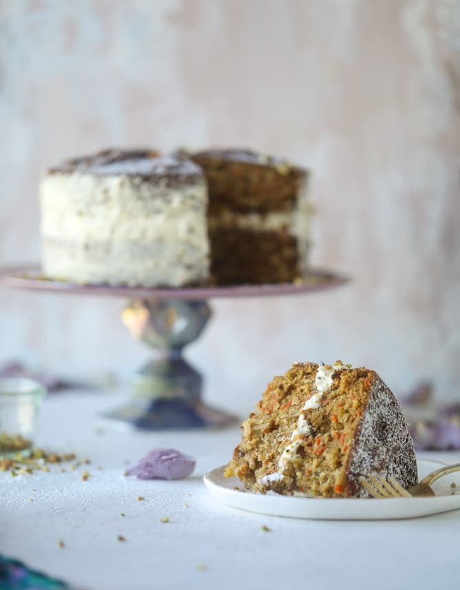 pistachio carrot cake with cream cheese frosting I howsweeteats.com #carrotcake #pistachio #cake #creamcheese #frosting
