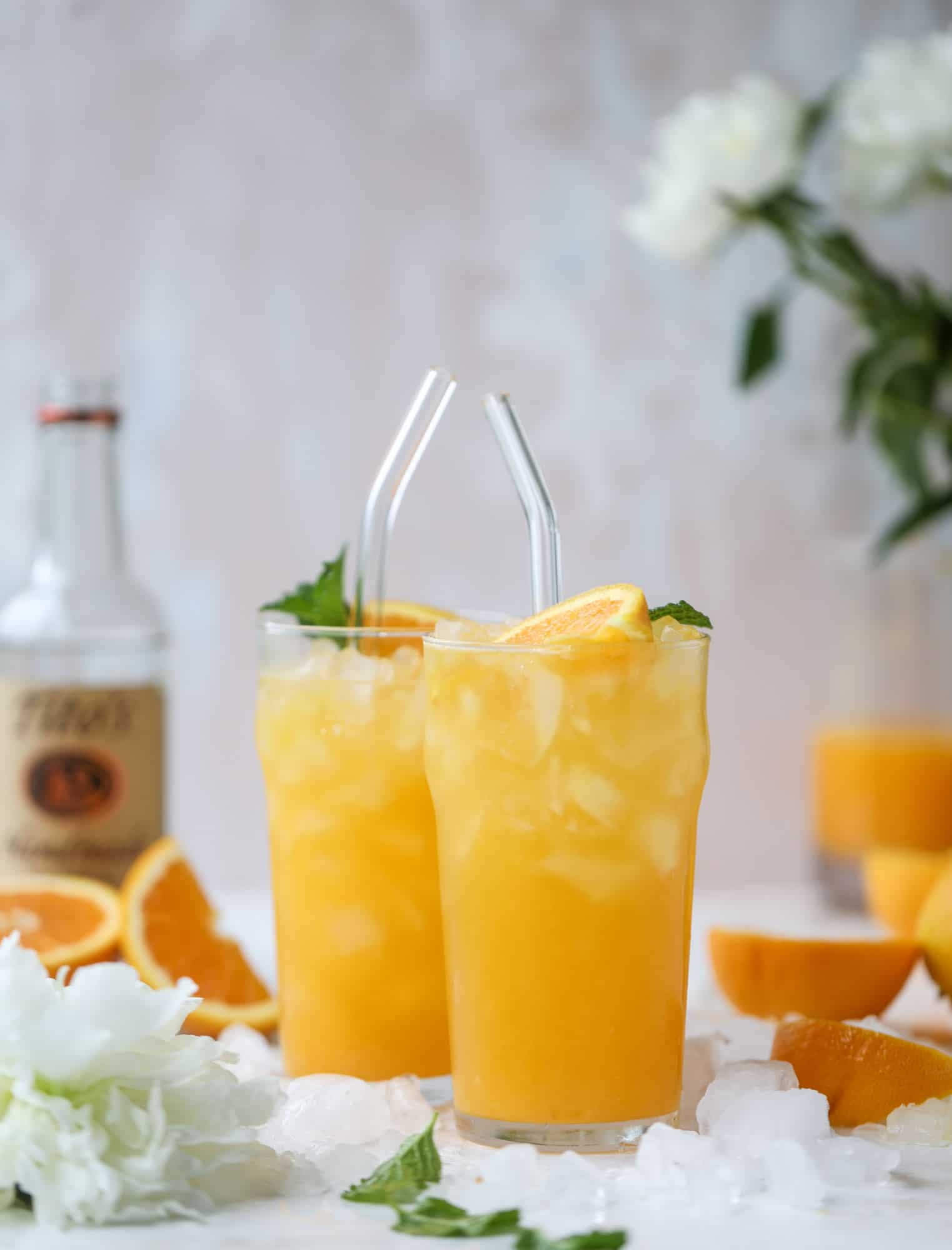 This orange crush is a copycat cocktail from the ones served in Ocean City, Maryland at the beach all summer long! It's one entire freshly squeezed orange with vodka and lemon lime soda and it tastes like heaven. Super refreshing and perfect for summer. I howsweeteats.com #orange #crush #cocktail #ocean #city #vodka
