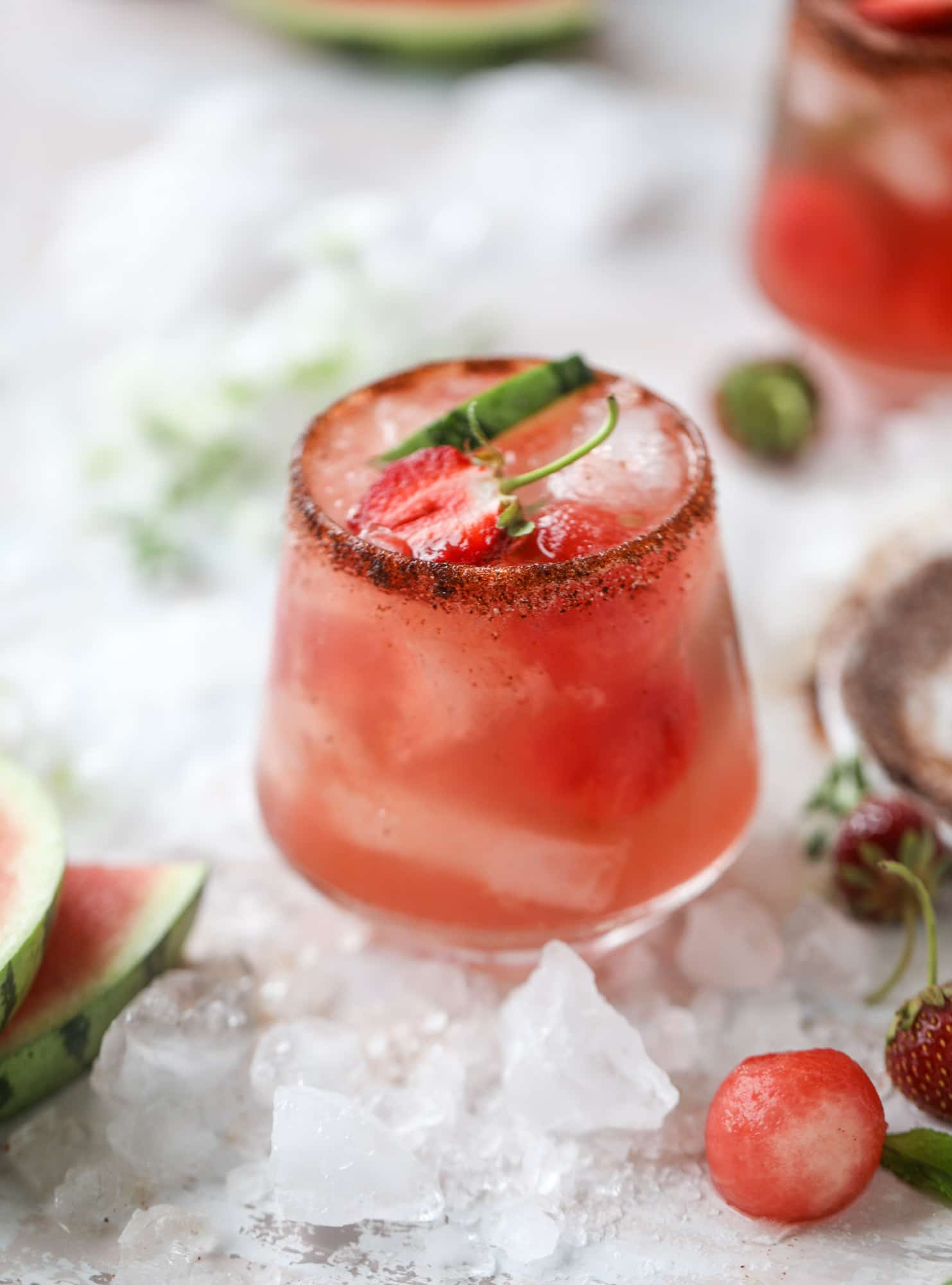 This spicy watermelon sangria is super refreshing, light, delicious and perfect for a hot summer day! Complete with an entire bottle of rosé, watermelon juice, melon balls, strawberries and brandy, this is the best summer cocktail in a pitcher! I howsweeteats.com #spicy #watermelon #sangria #cocktails #rosé
