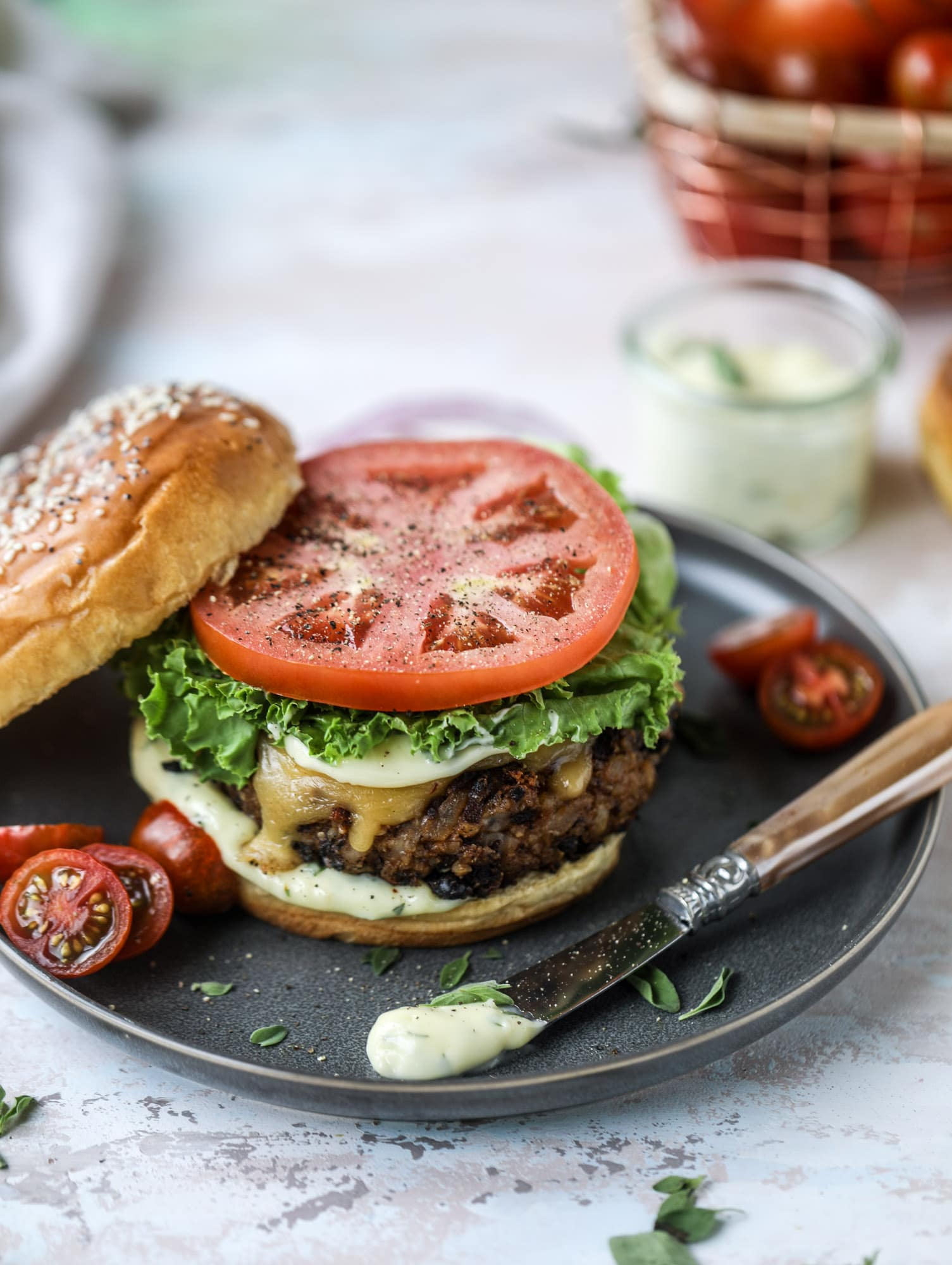 This is the best ever veggie burger and that is not an exaggeration! It's delicious, full of texture and chew, super satisfying and actually sticks together in the pan. You can serve it on buns, make a patty melt, a salad or lettuce wraps - perfection! I howsweeteats.com #best #veggie #burger #vegetarian #beans #quinoa