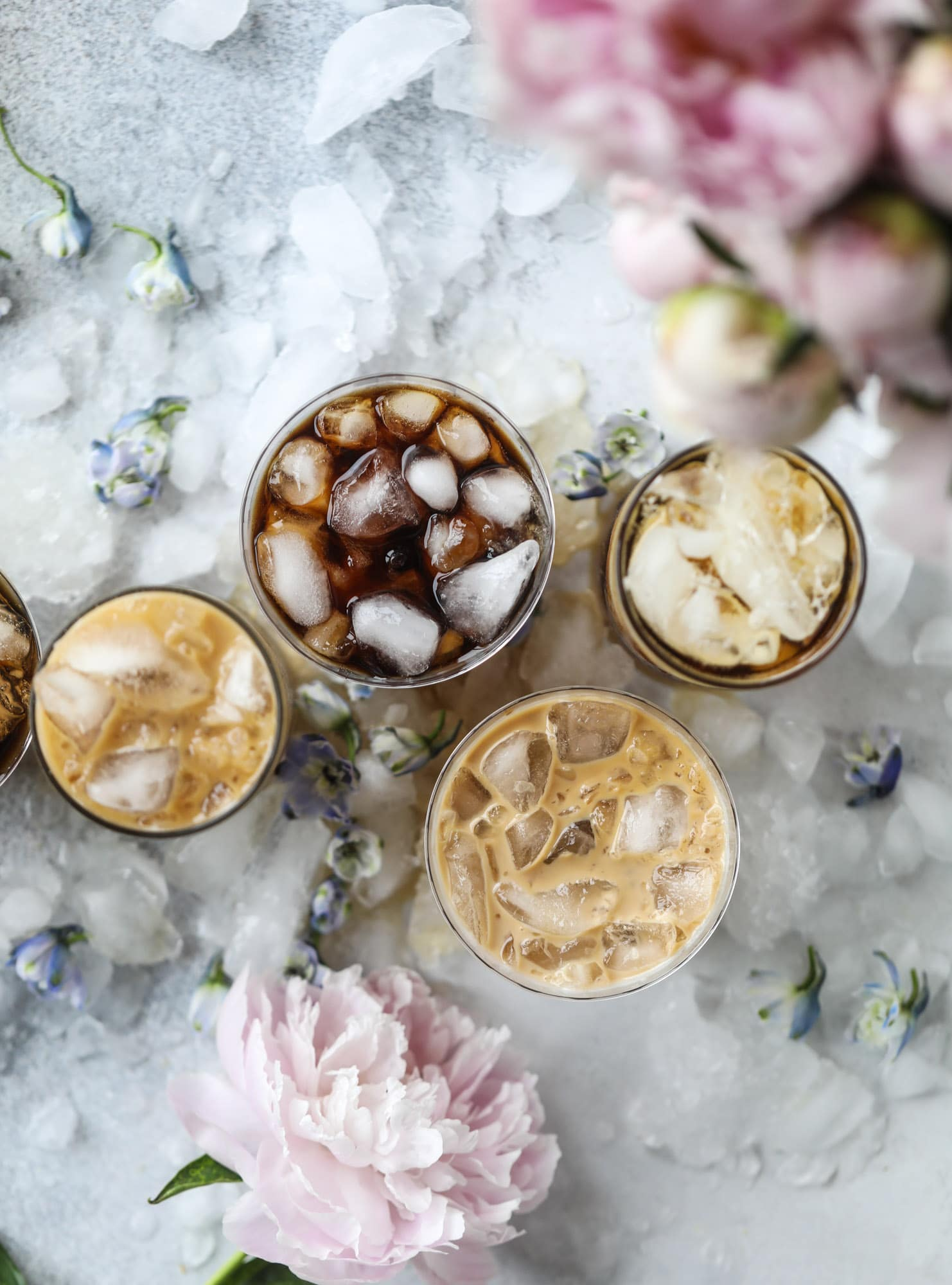 This iced coffee soda is so perfect for summer! Rich coconut syrup, cold brew coffee, cream (or coconut cream!) if you'd like it and lots of bubbly soda. Tastes refreshing, feels like a cocktail and still gives you a pick-me-up! I howsweeteats.com #iced #coffee #soda #coconut