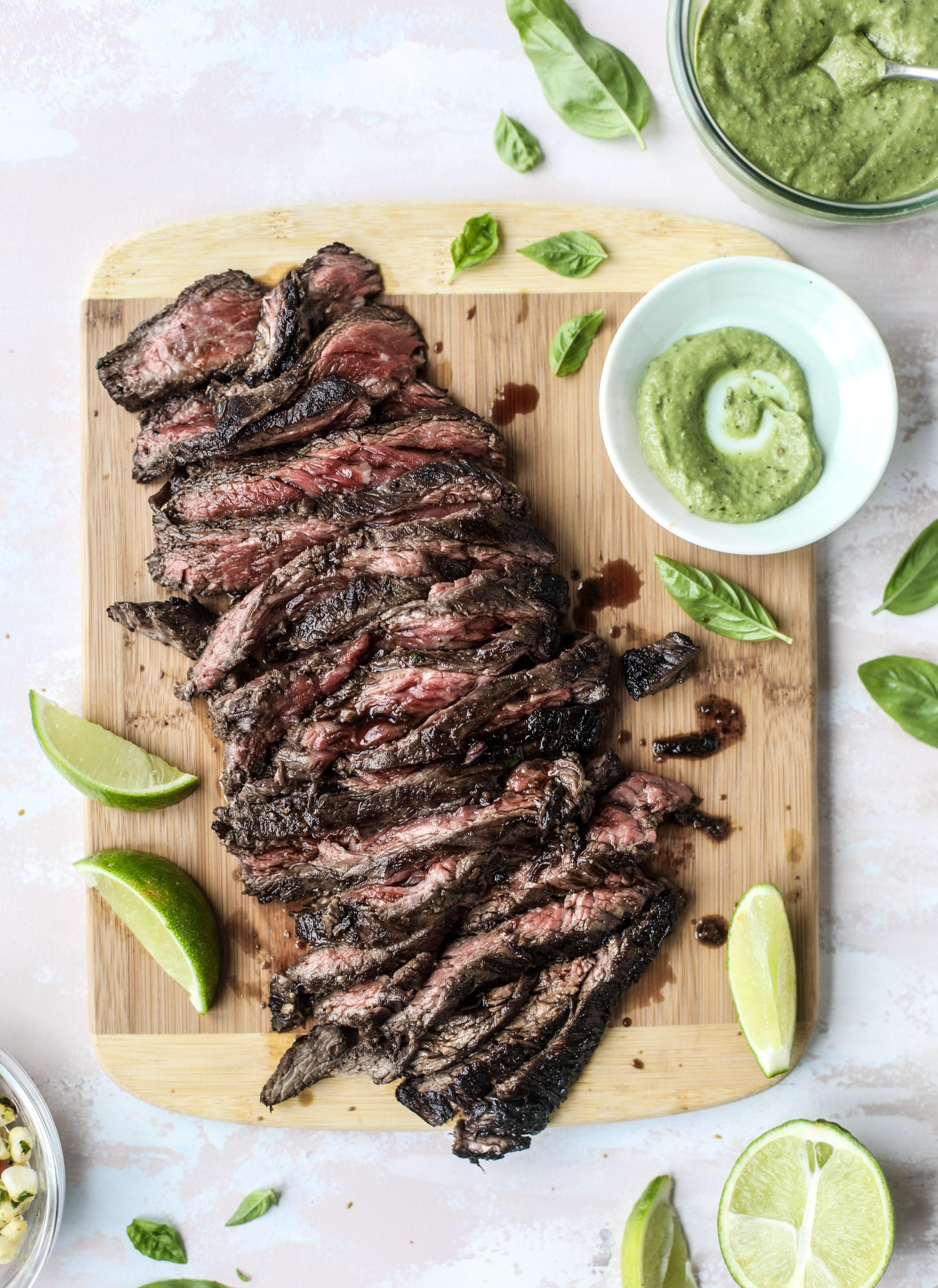 This skirt steak recipe is so super easy and delicious! Marinate it for a bit, prepare it to your liking then serve it with the most flavorful avocado pesto and grilled corn relish. Feels like a fancy restaurant meal and will make you love skirt steak forever! I howsweeteats.com #skirt #steak #avocado #pesto #corn #relish #recipes