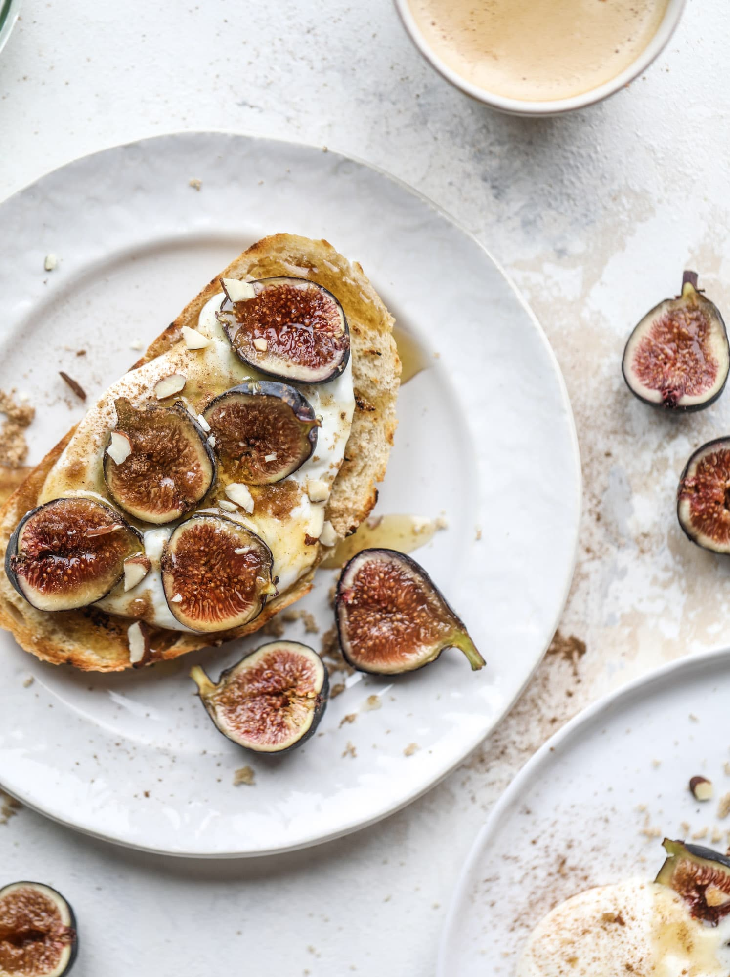 This cinnamon sugar toast is an absolutely dream! It's spread with a cinnamon brown sugar butter, grilled to perfection and served with creamy whipped ricotta cheese, fresh figs, honey, cinnamon and sliced almonds. I howsweeteats.com #cinnamon #sugar #toast #ricotta #figs #breakfast