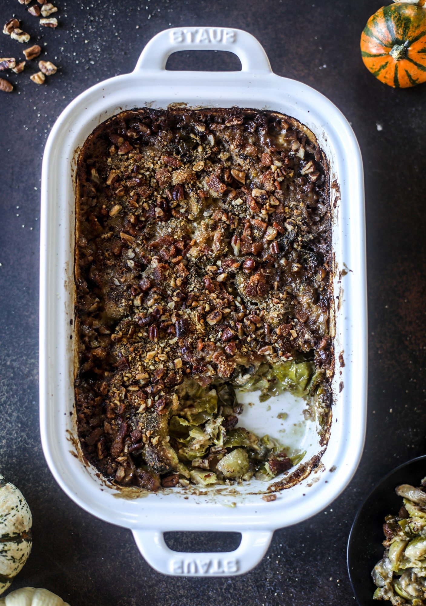This brussels sprouts gratin is heaven in a dish! It's super flavorful, delicious and comes together to create a fabulous side dish for Thanksgiving or the holidays. Pancetta and cheese turn this in to flavor town - you won't be able to stop eating it! I howsweeteats.com #brusselssprouts #gratin