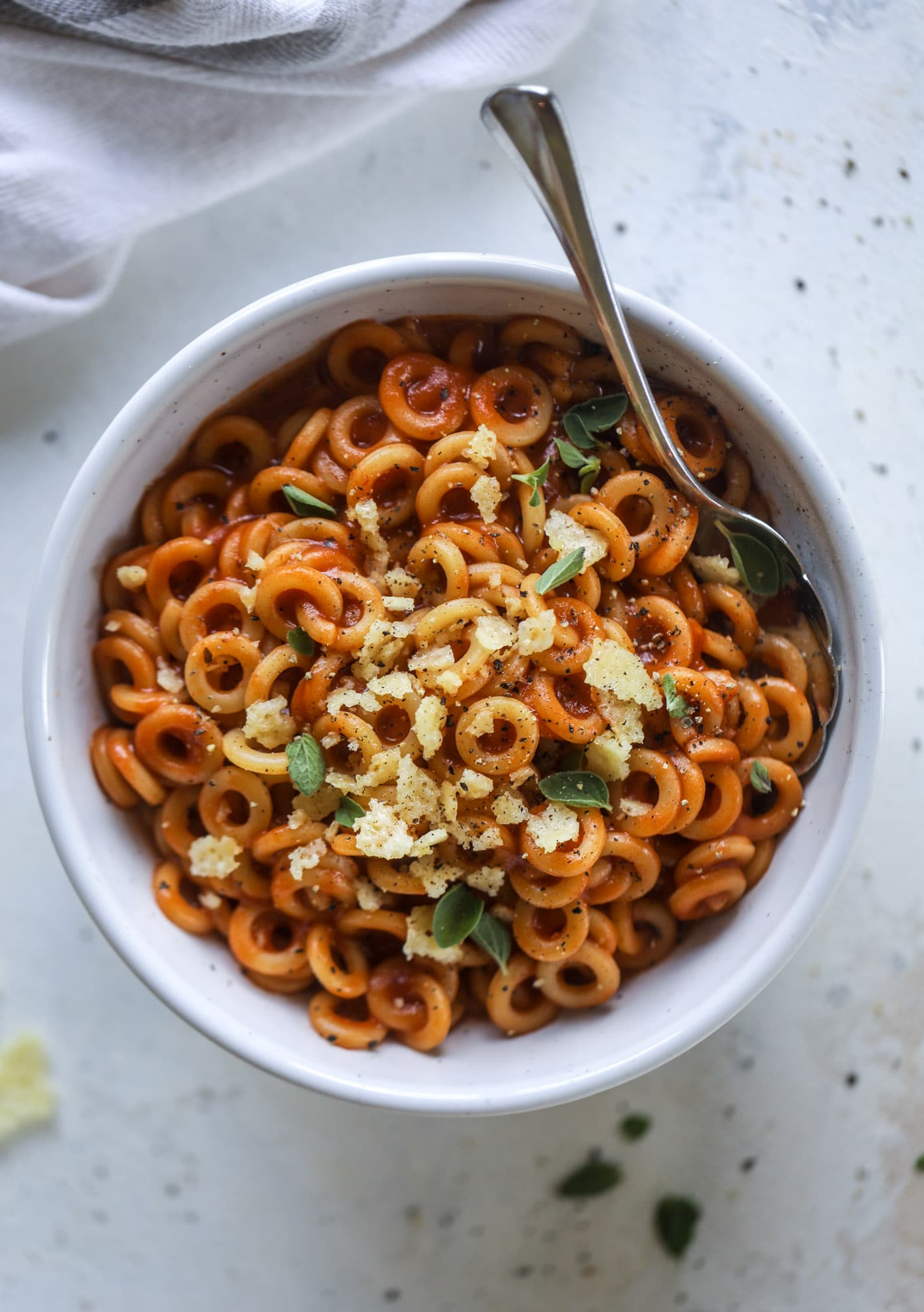 These homemade spaghettios are the ultimate comfort food! They come together in less than 30 minutes, are super easy and flavorful and topped with crispy crunchy manchego cheese that takes the taste over the top! I howsweeteats.com #homemade #spaghettios
