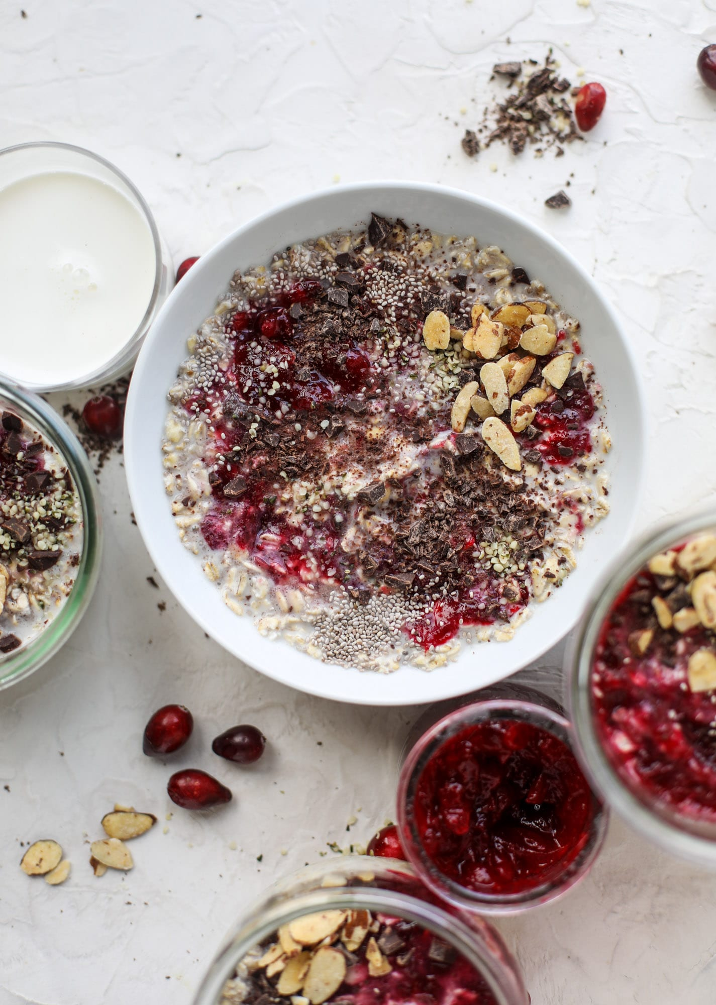 These leftover cranberry overnight oats are the perfect post-Thanksgiving breakfast! Leftover cranberry sauce and dark chocolate come together to flavor chewy, chilled overnight oats. Add on sliced almonds, chia seeds and hemp hearts for more deliciousness! I howsweeteats.com #overnight #oats