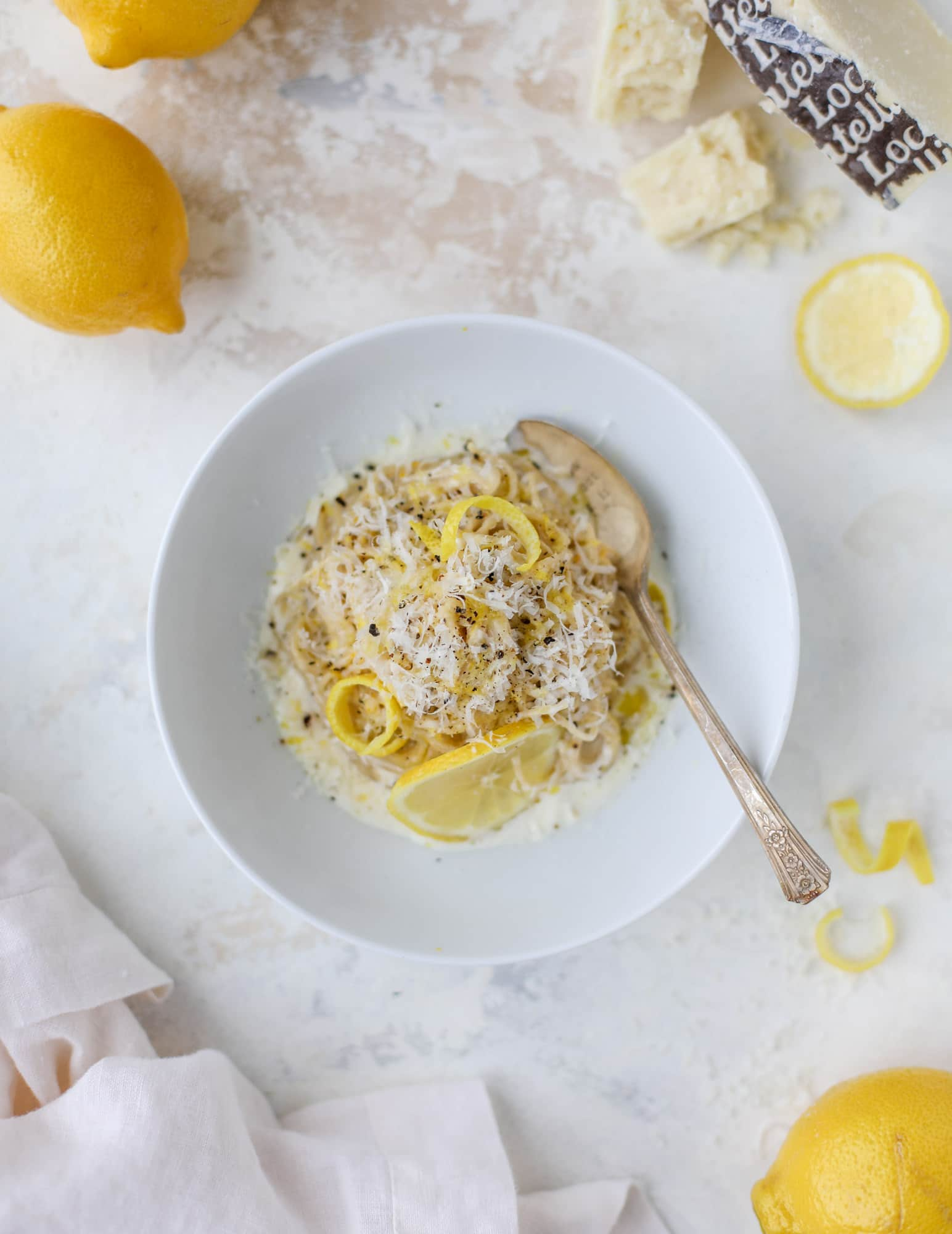 This cozy lemon pasta is light, refreshing and perfect for dinner when paired with a simple greens salad. It comes together in 20 minutes! I howsweeteats.com #lemon #pasta