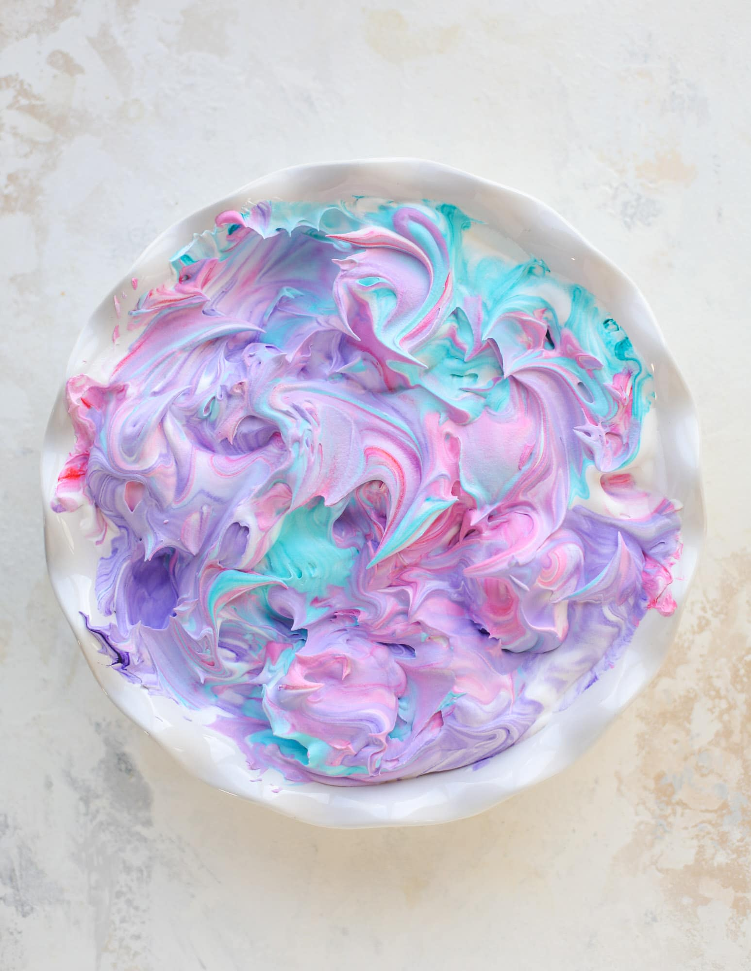 This is how to dye eggs with cool whip! It's so fun, super kid-friendly and ridiculously easy too. I love using this method to make unicorn eggs!