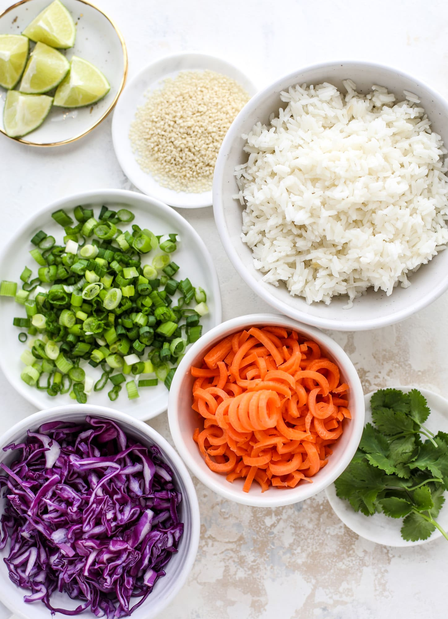 Korean chicken bowls are loaded with flavor: toasted sesame, soy sauce and lime come together over coconut rice and avocado to create a delicious meal! I howsweeteats.com #korean #chicken