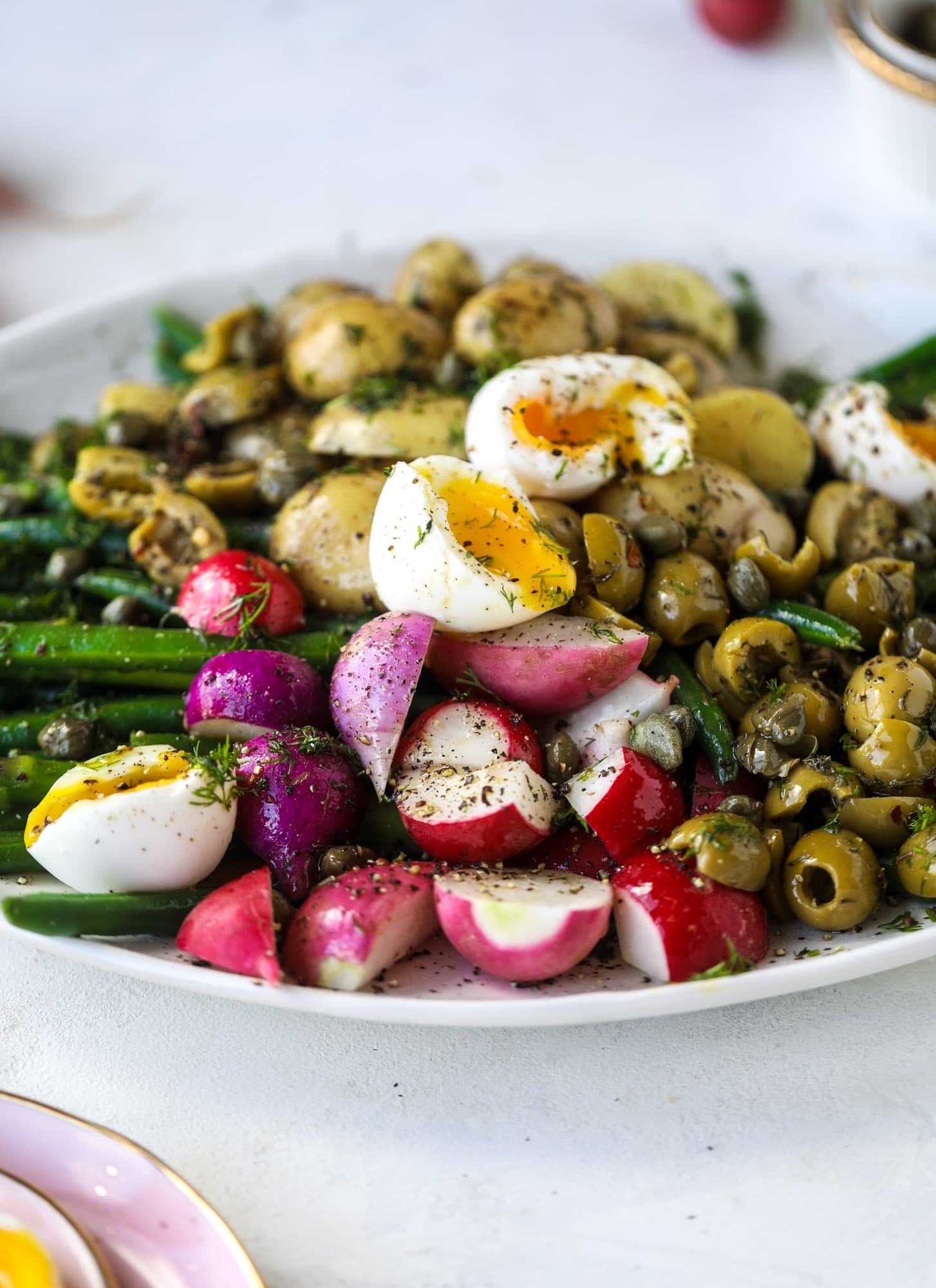 soft boiled eggs on a perfect spring salad