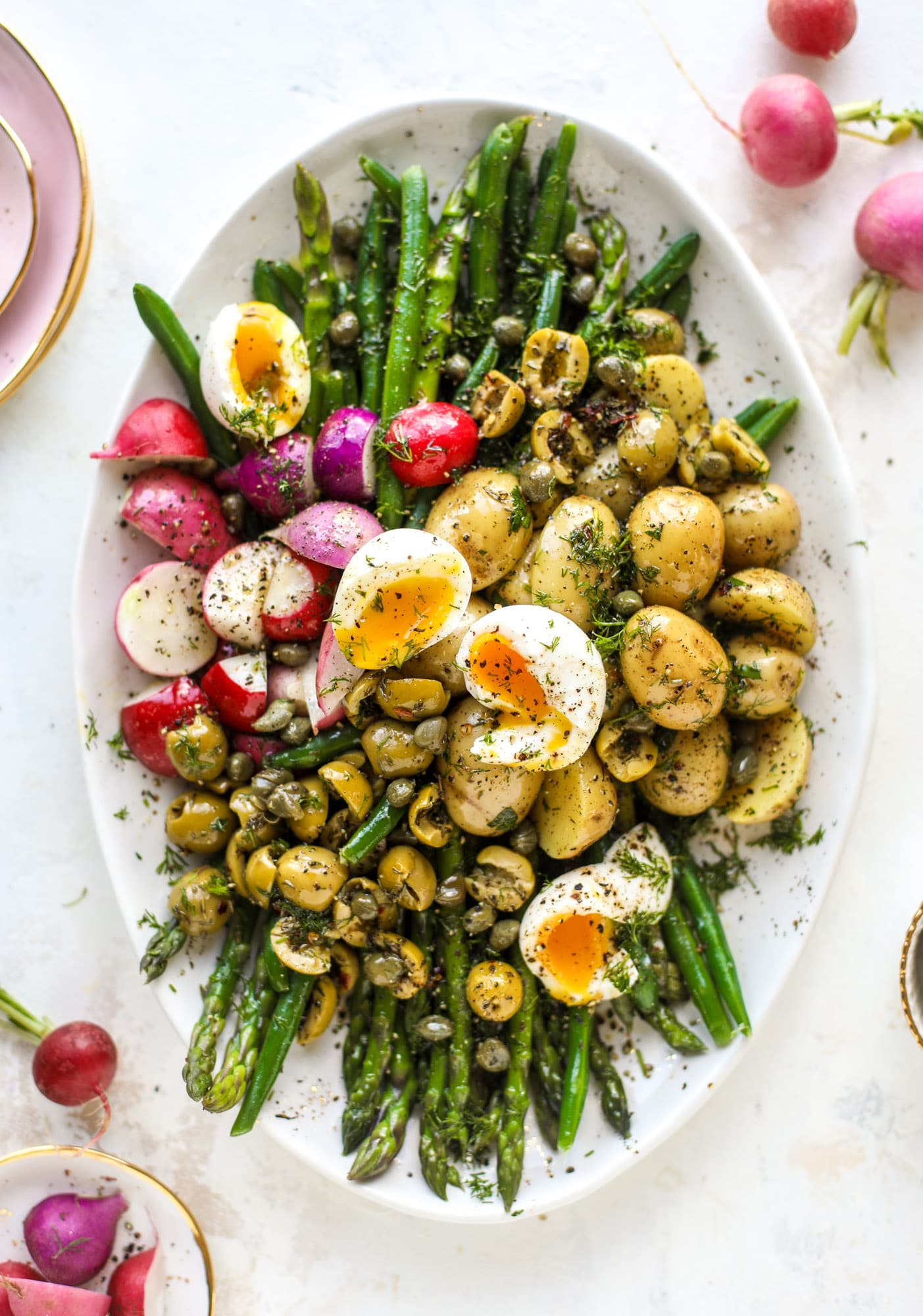 This spring version of the nicoise salad is loaded with crunchy green beans and asparagus, gorgeous radishes, tender potatoes and salty olives.