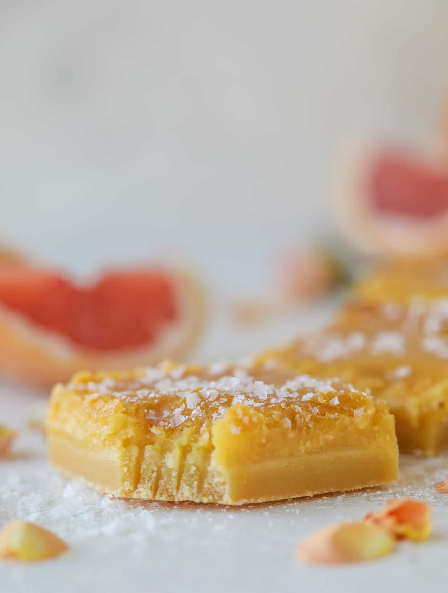 These salted citrus bars are made of both grapefruit and lemon curd on a buttery shortbread crust. Top with flaked sea salt for the perfect bite!