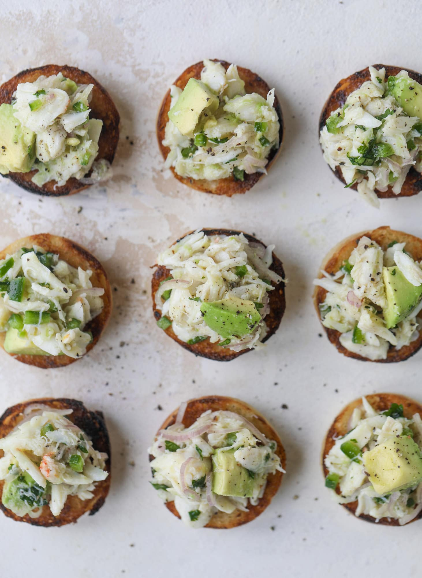 The cutest crab salad toasts are perfect for a snack, appetizer or light meal with a greens salad. This avocado crab salad is so refreshing and light!