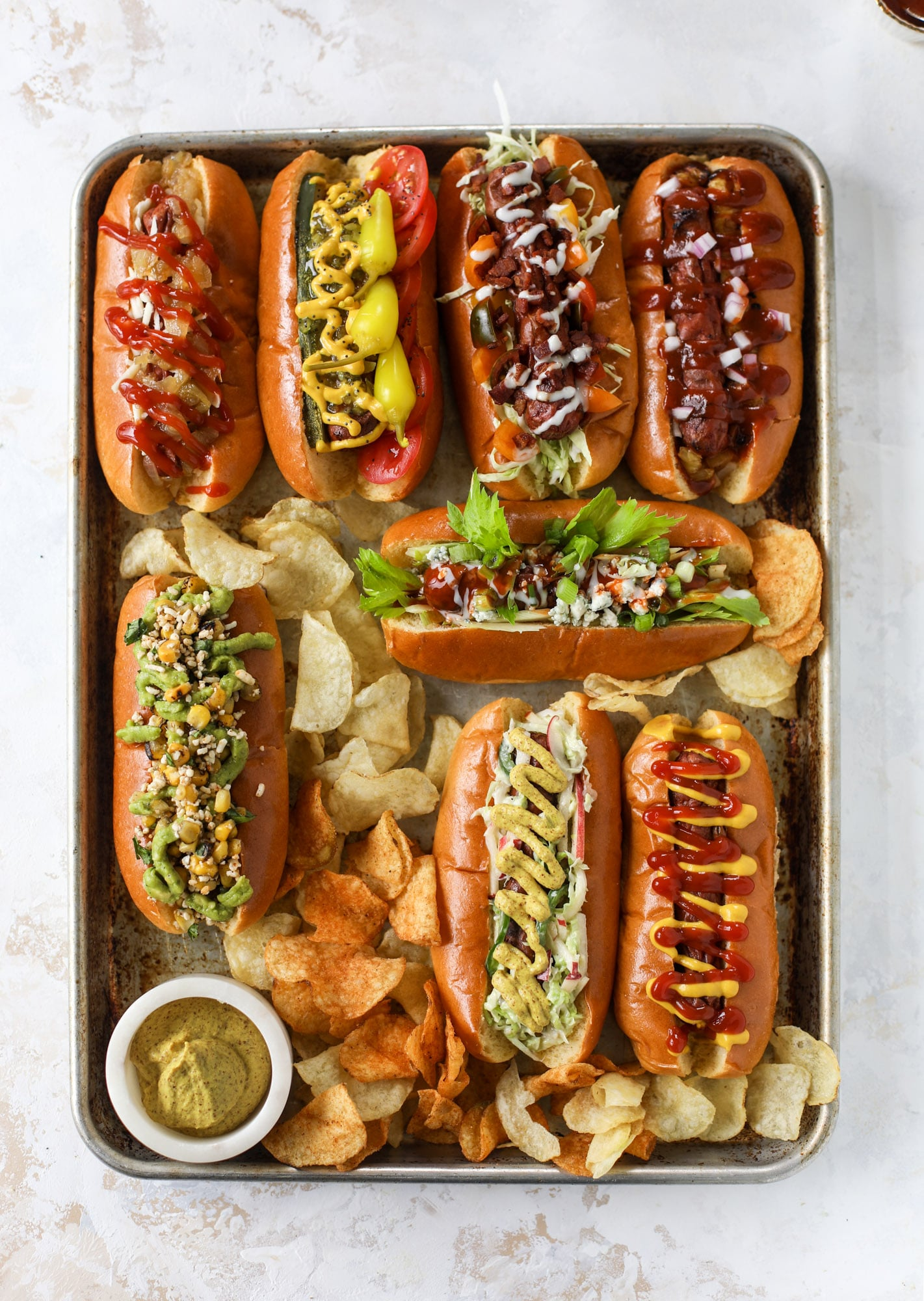 Nothing screams summer more than a hot dog bar! Grab your buns and dogs and a whole lot of toppings. This is super fun and delicious!