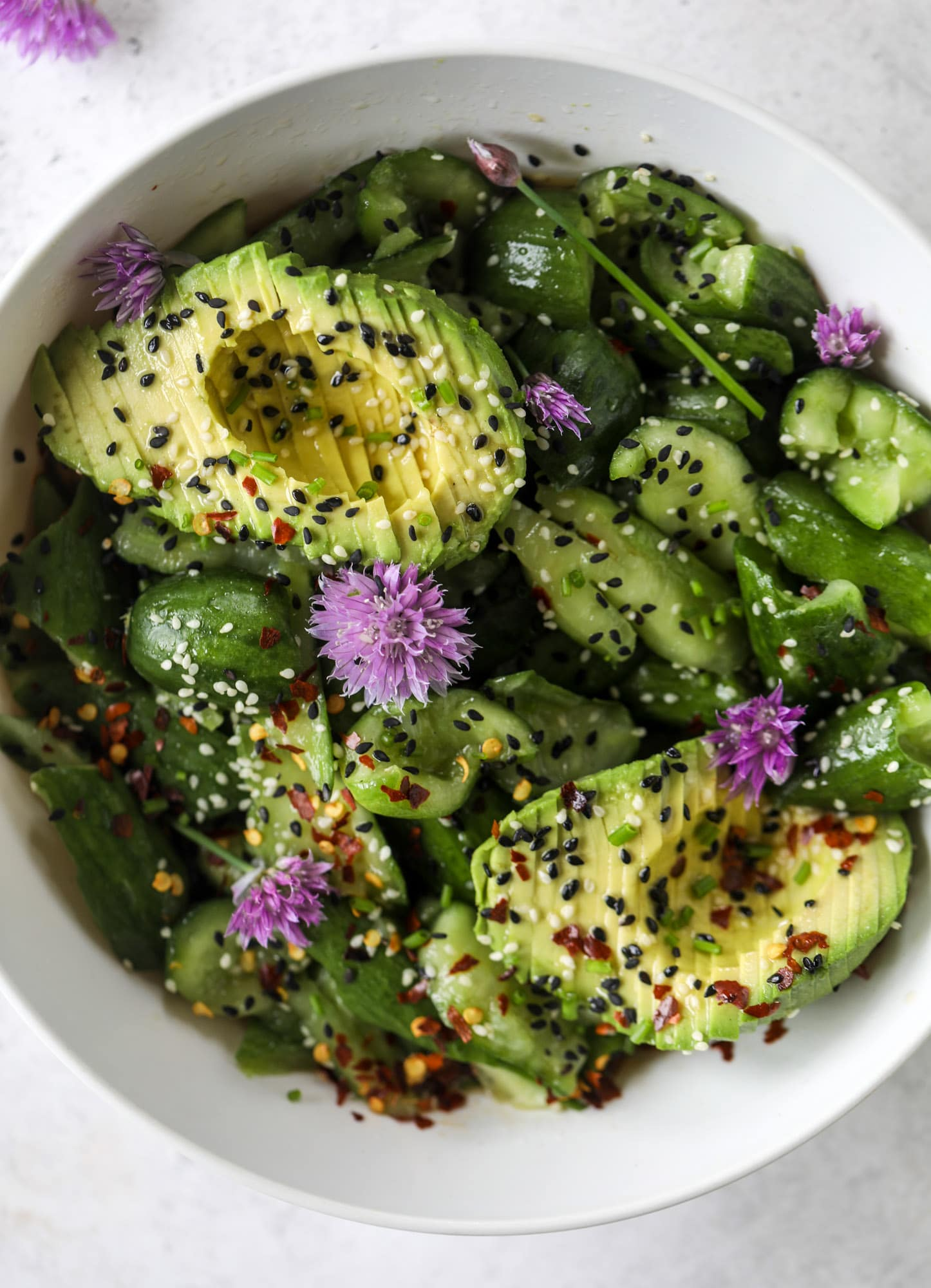 This smashed cucumber salad is so refreshing and perfect for summer! Served with avocado, toasted sesame oil and chives, it's ridiculously flavorful.