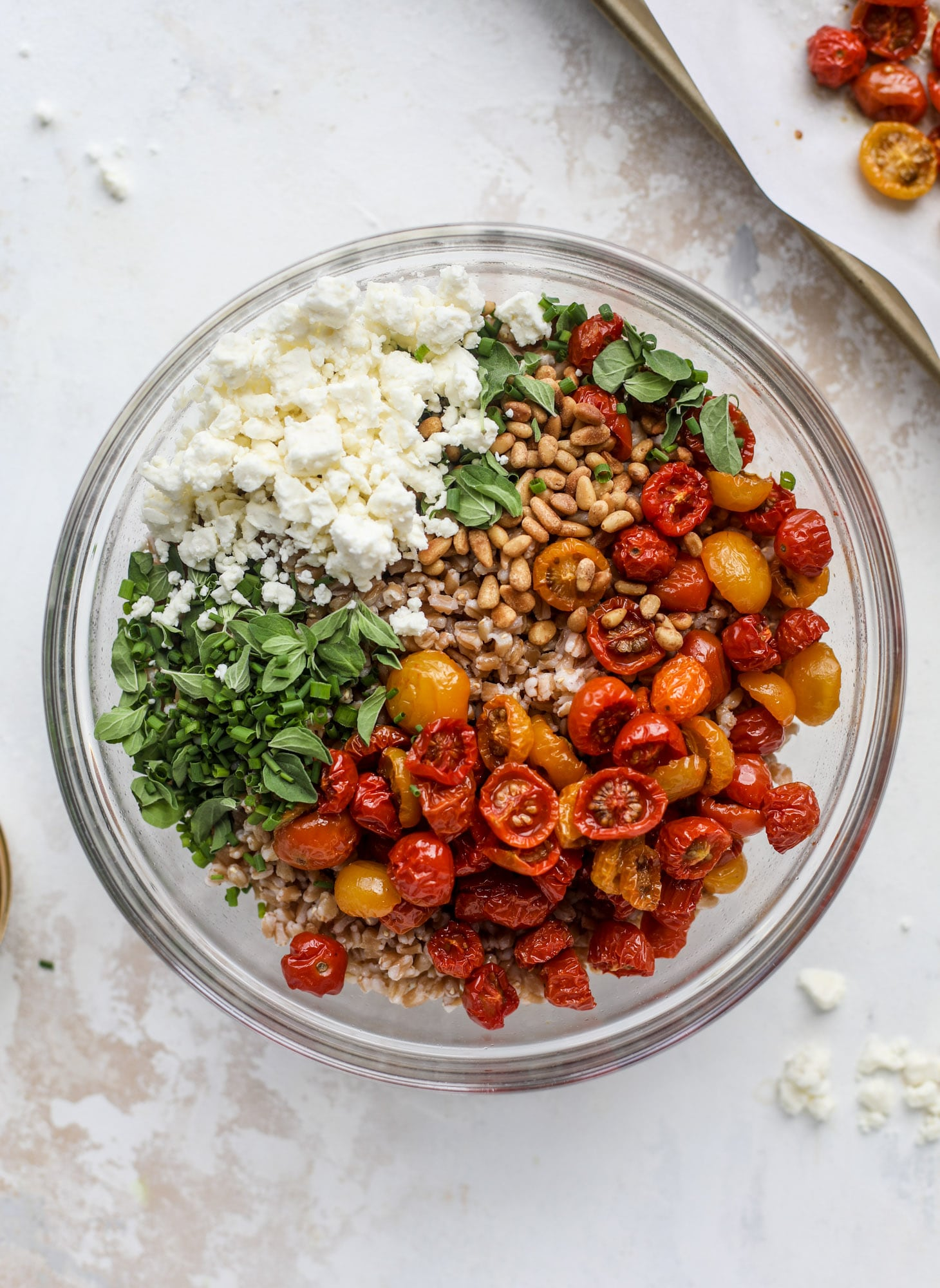 A tomato farro salad that is sweet from the slow roasted tomatoes, tangy from the feta cheese, chewy from the farro and bright from the lemon!