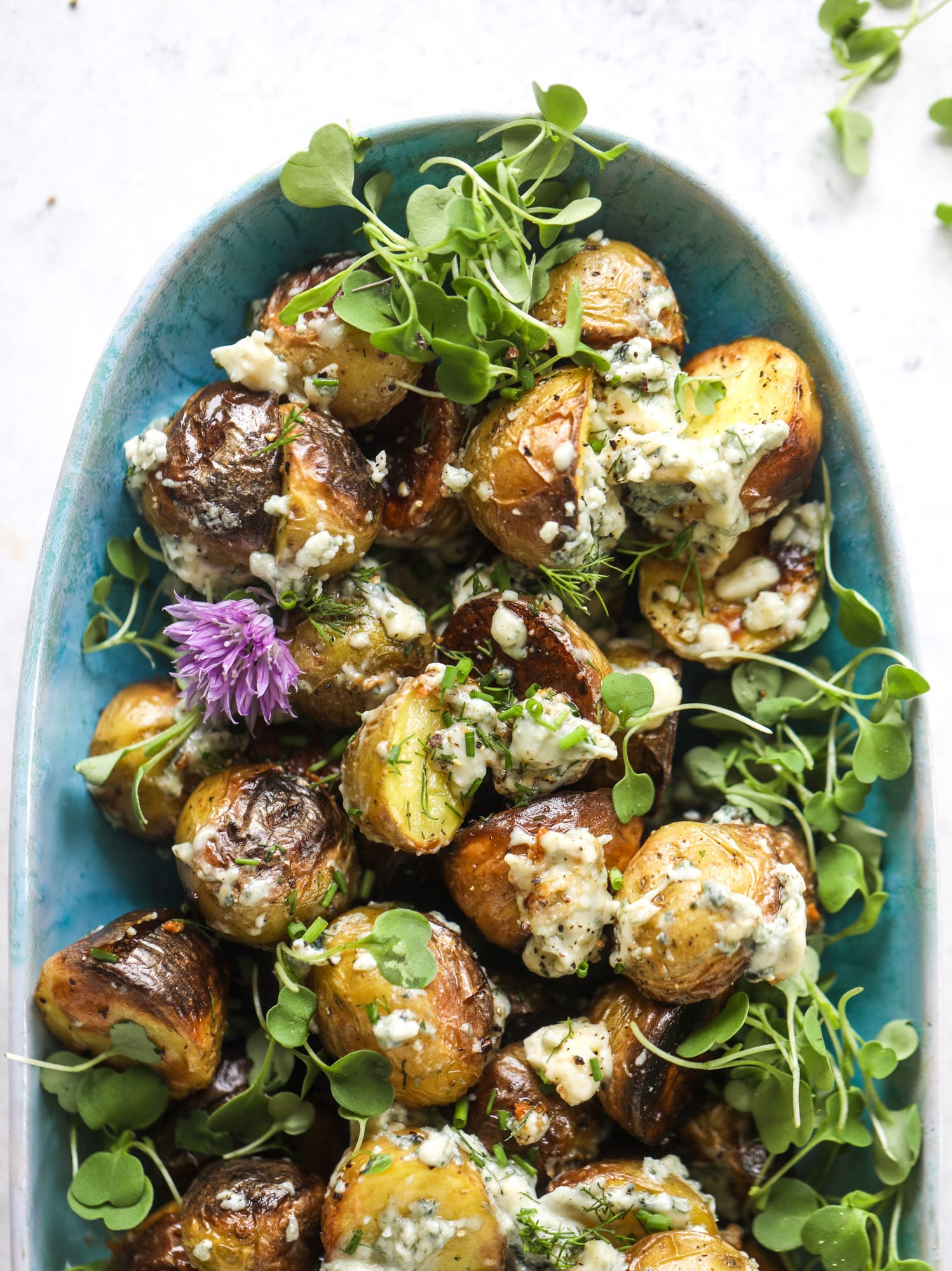 These grilled gorgonzola potatoes are loaded with flavor! Crispy, crunchy grilled bab golds topped with creamy blue cheese and fresh herbs.
