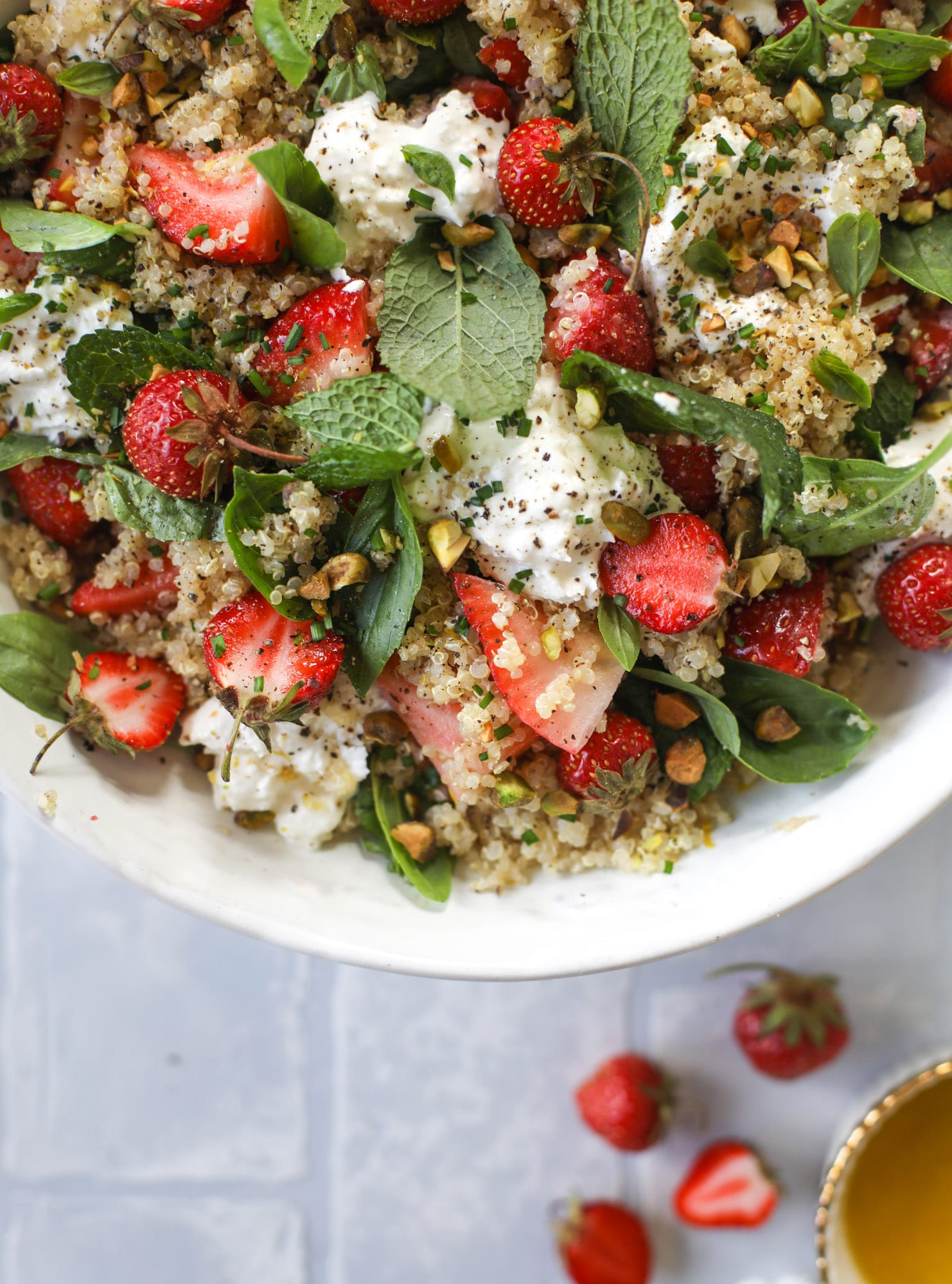 This strawberry quinoa salad is loaded with fresh herbs, burrata cheese and chopped pistachios. Topped with a lemon dressing, it's heavenly!