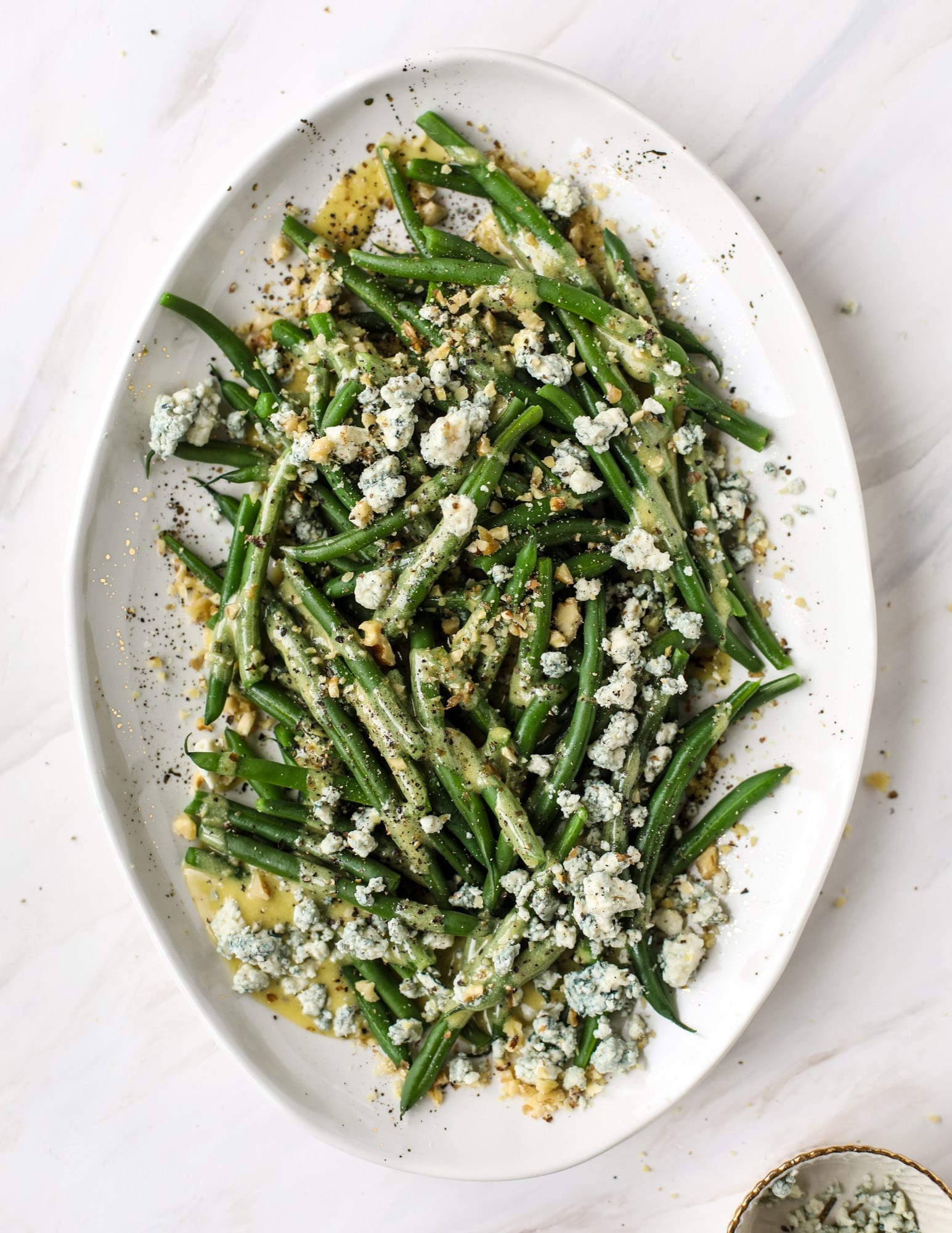 This fresh green bean salad is the ultimate summer side dish. Crisp green beans, creamy blue cheese, chopped walnuts and a dijon dressing. It's beyond!
