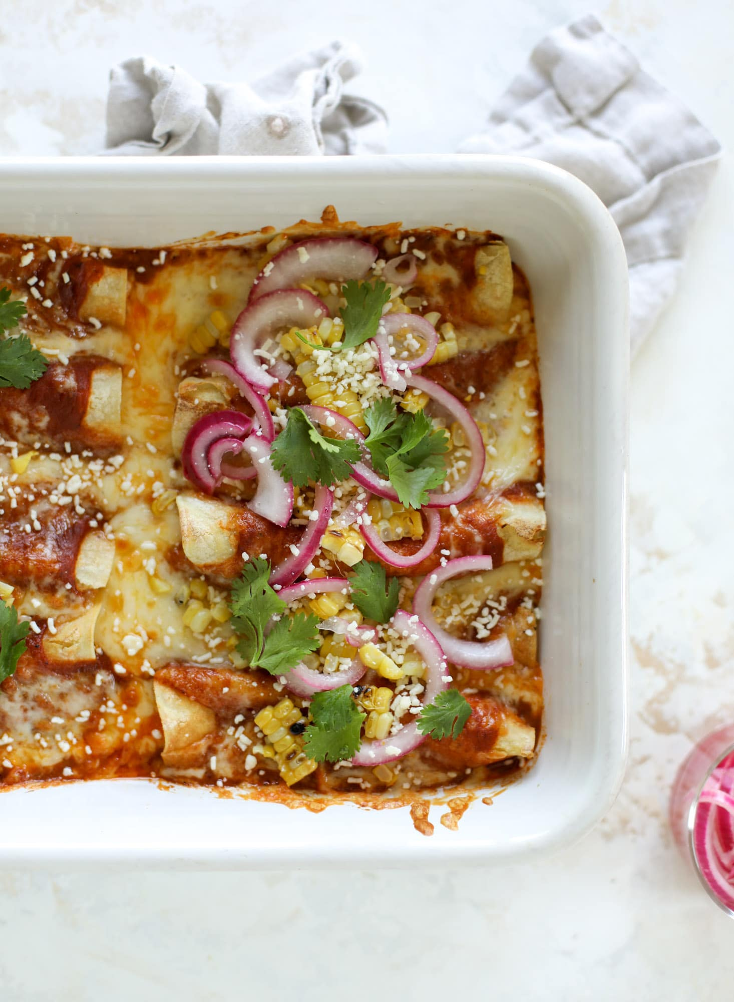 These grilled corn enchiladas are the perfect summer meal! Grilled corn, zucchini, homemade sauce and cheese come together for a flavor explosion!