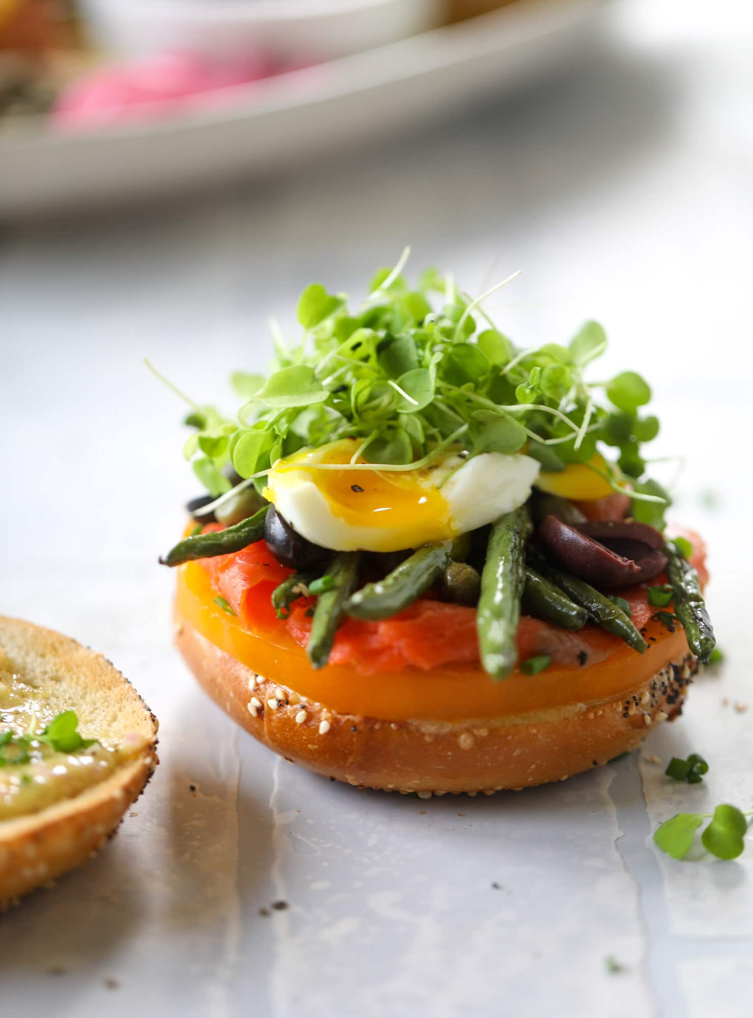 These nicoise bagels are a spin on my favorite salad! Loaded with smoked salmon, blistered green beans and tons of goodness. They are delish!