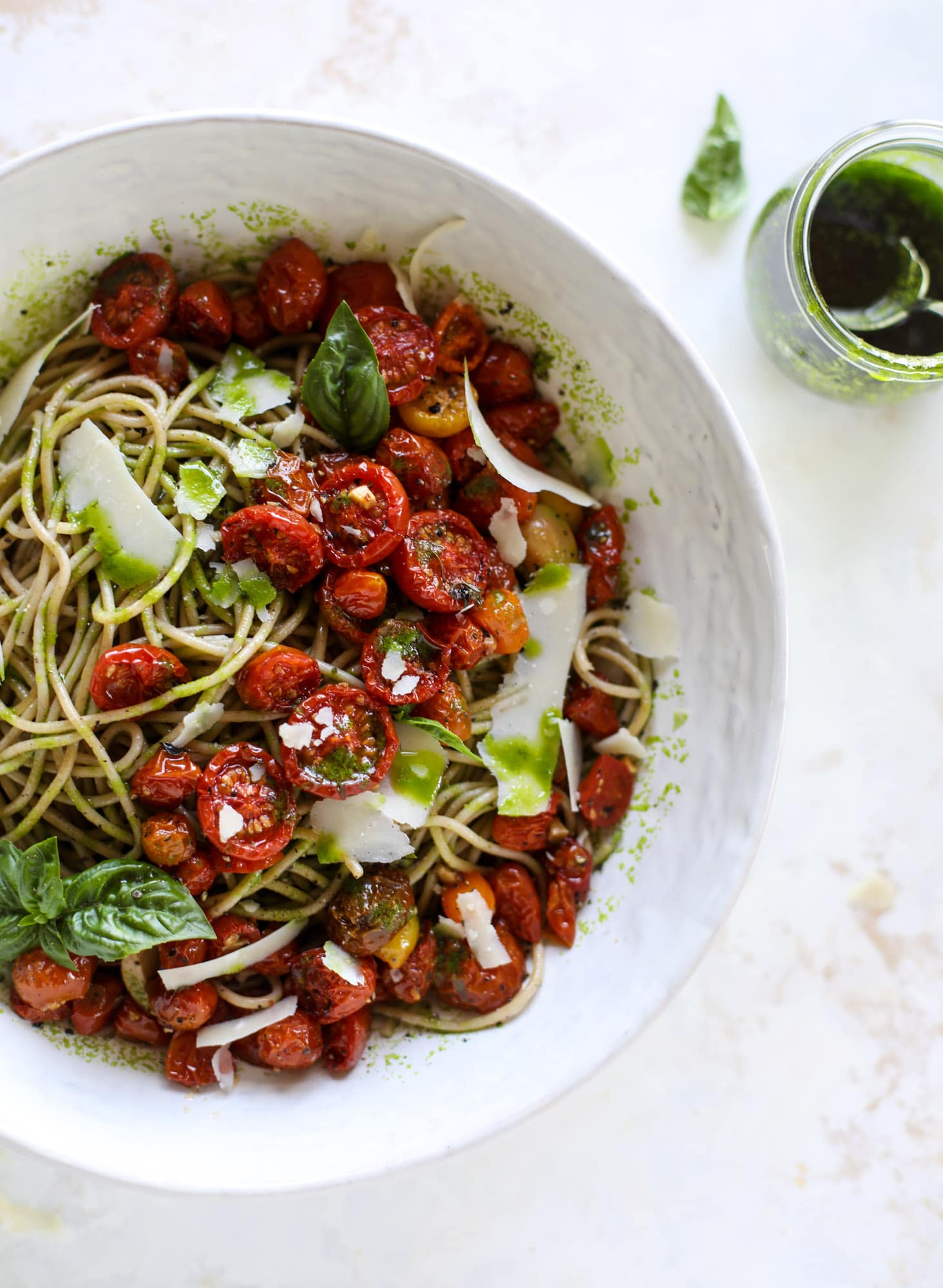 This tomato basil pasta is a labor of love! Made with slow roasted tomatoes, basil oil and tons of parmesan, it's ridiculously full of flavor.