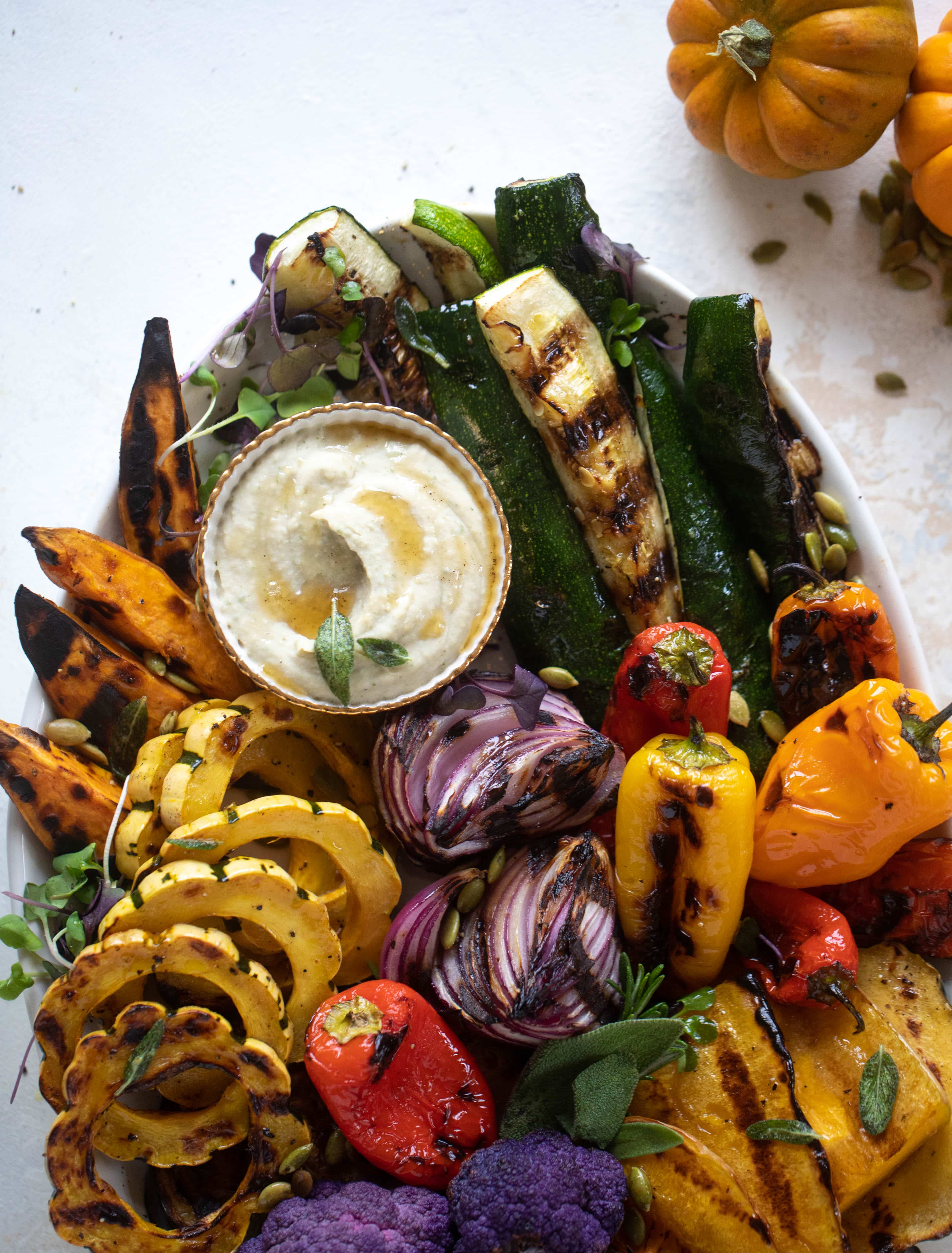 These grilled autumn vegetables make the best side dish or appetizer! Especially when served with the sage brown butter white bean dip. YUM.