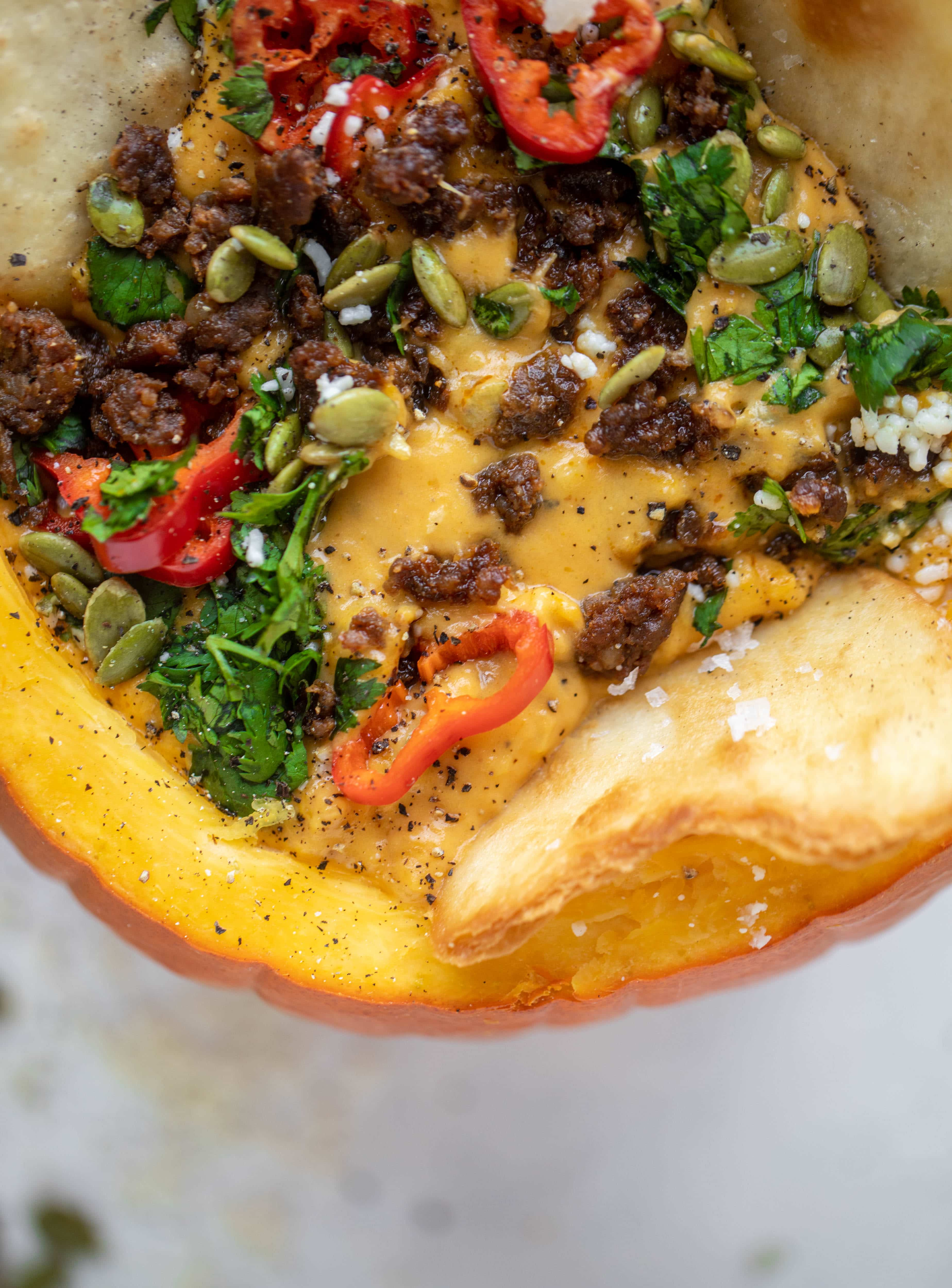 This pumpkin queso fundido is the perfect indulgence for fall. Warm pumpkin queso topped with chroizo, pepitas and jalapeños. It's delish!