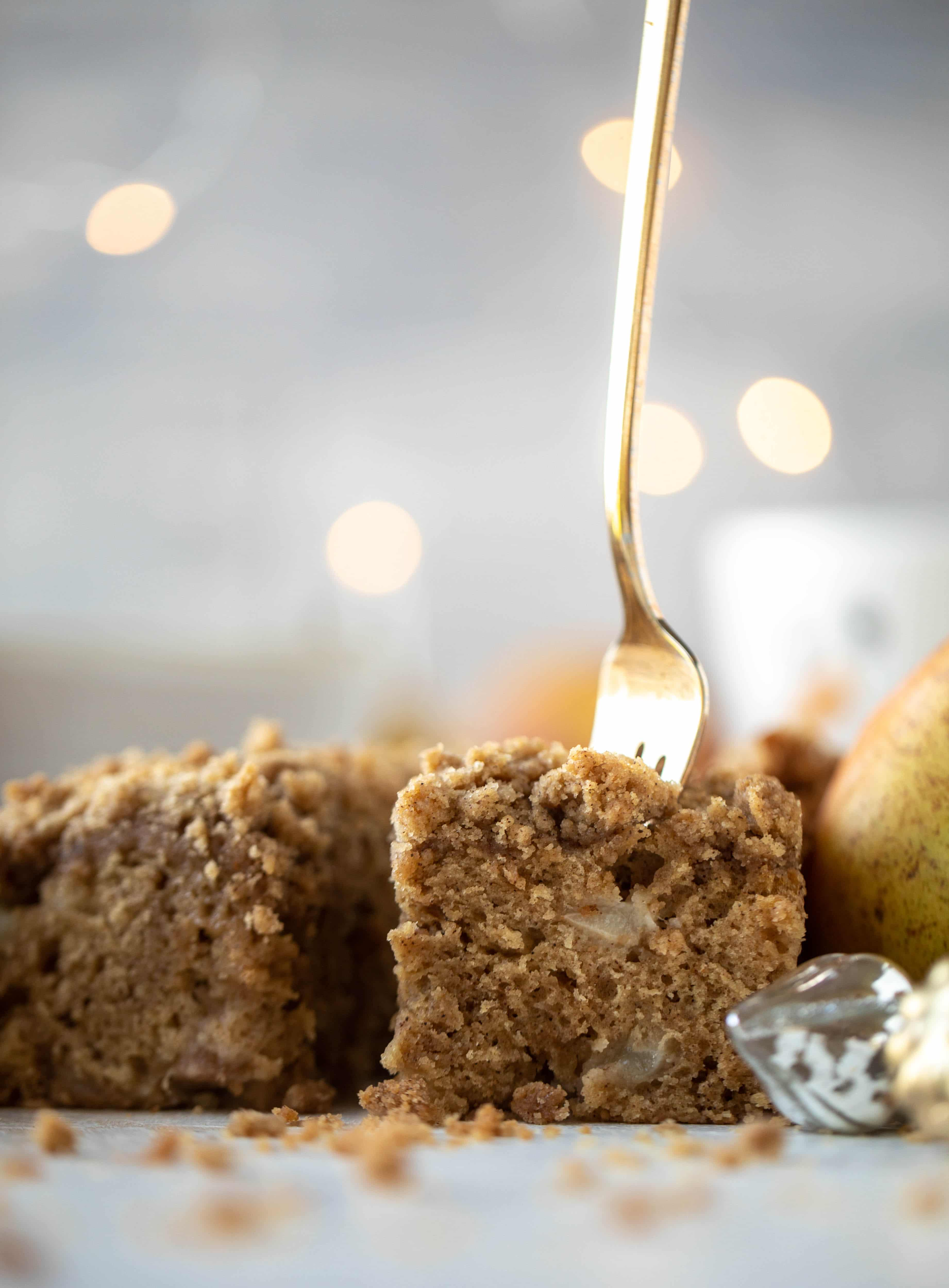 A pear coffee cake made with brown butter and greek yogurt. It's delicious for breakfast or brunch and the crumb topping is unbelievable.