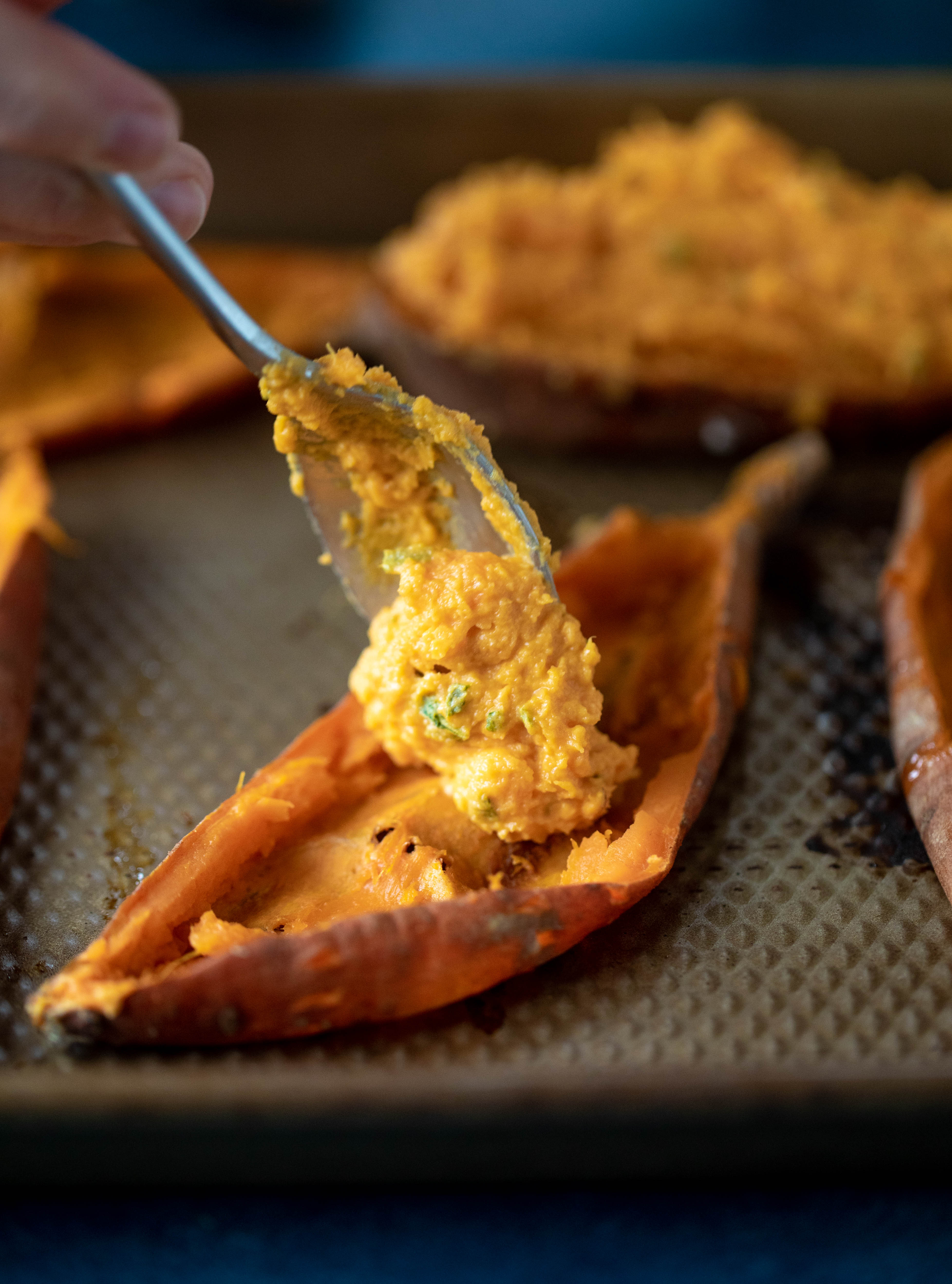 These twice baked sweet potatoes are whipped with crispy sage and pumpkin puree! Topped with cheese and baked until melty, they are super delish.