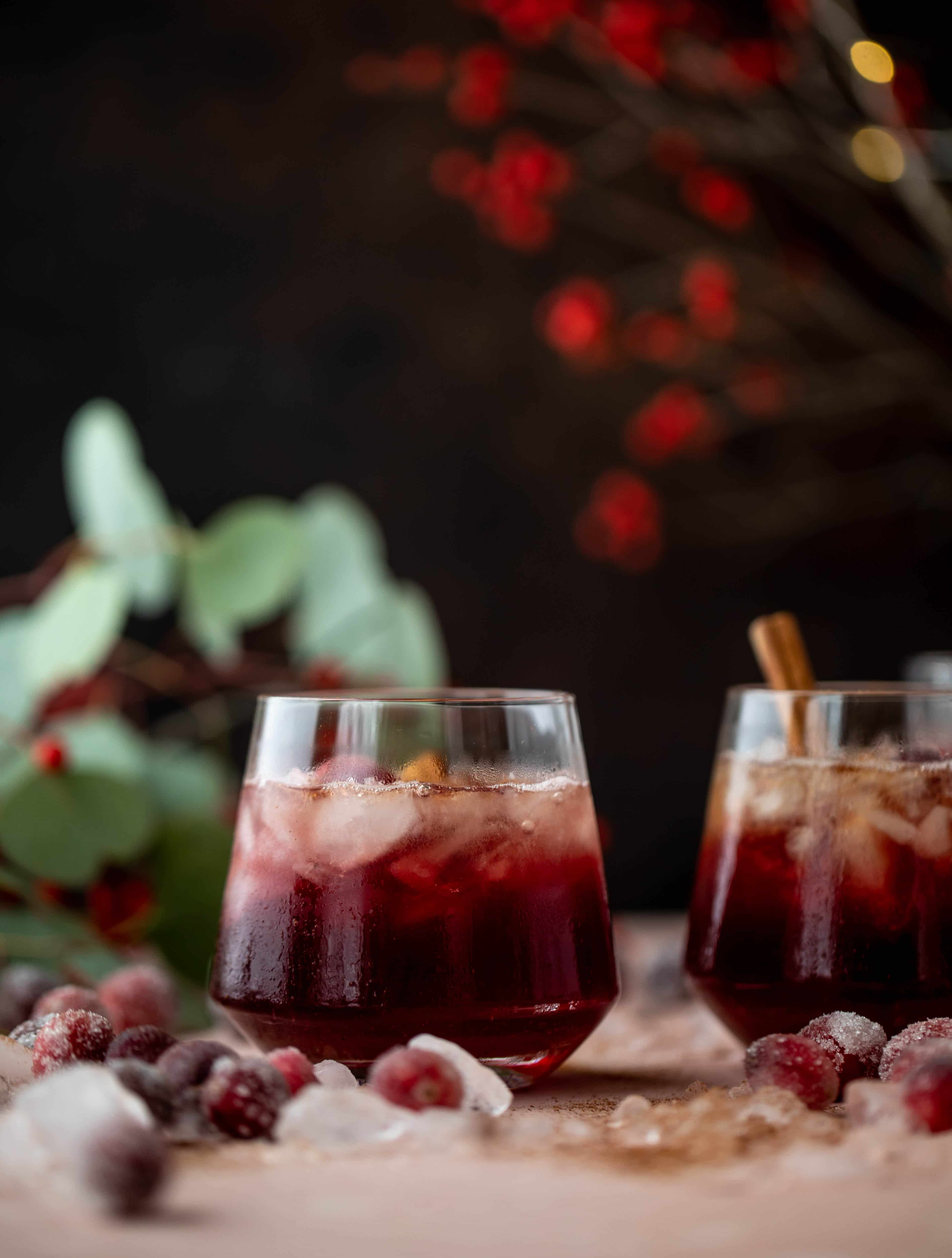 This cranberry cobbler smash is perfect for the holiday season! Bourbon, cinnamon simple syrup and cranberry juice - it's spiced and warming and wonderful.