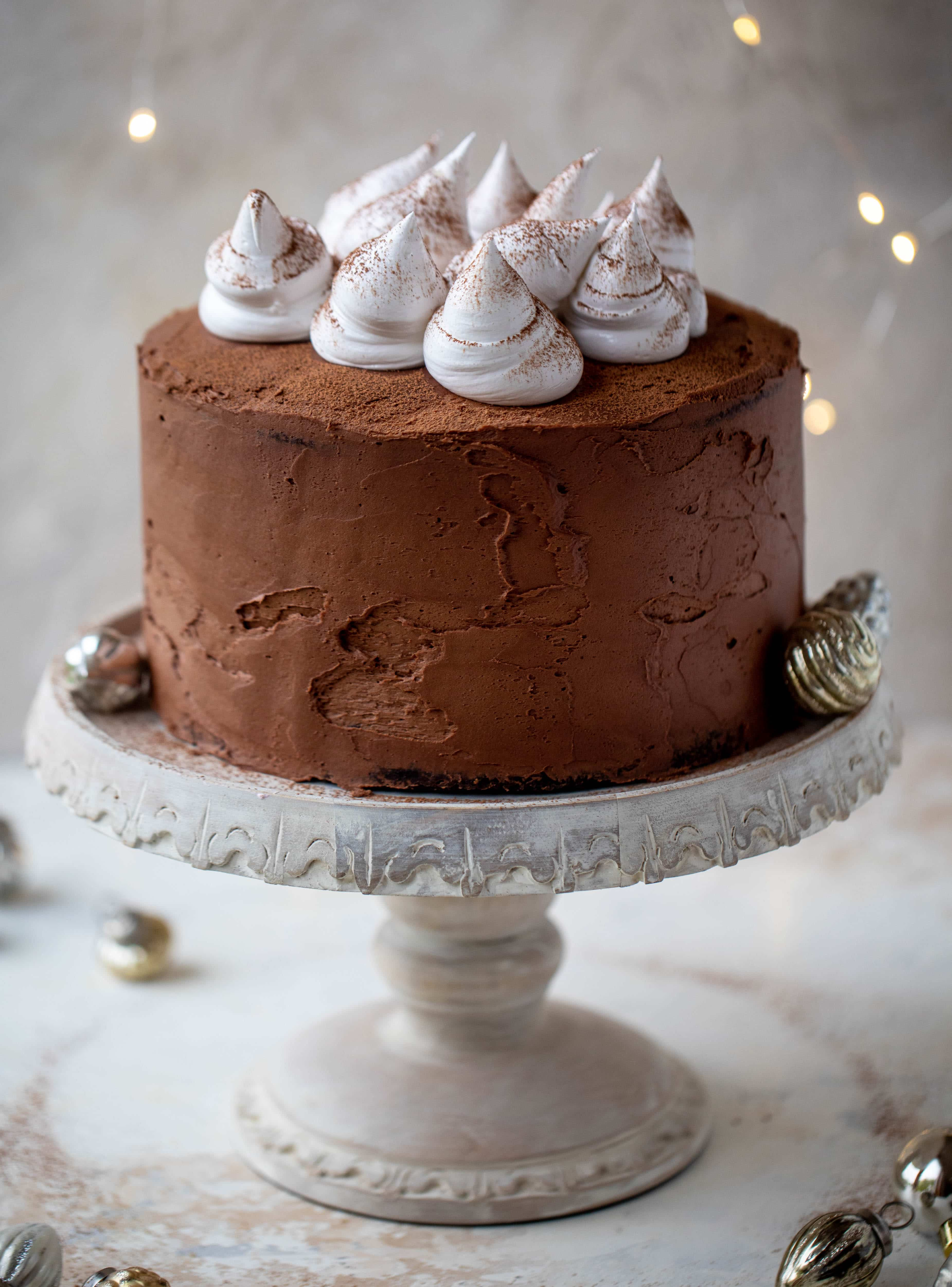 This hot cocoa cake is made with the fudgiest chocolate cake, smothered in chocolate cream cheese frosting and dolloped with whipped marshmallow!