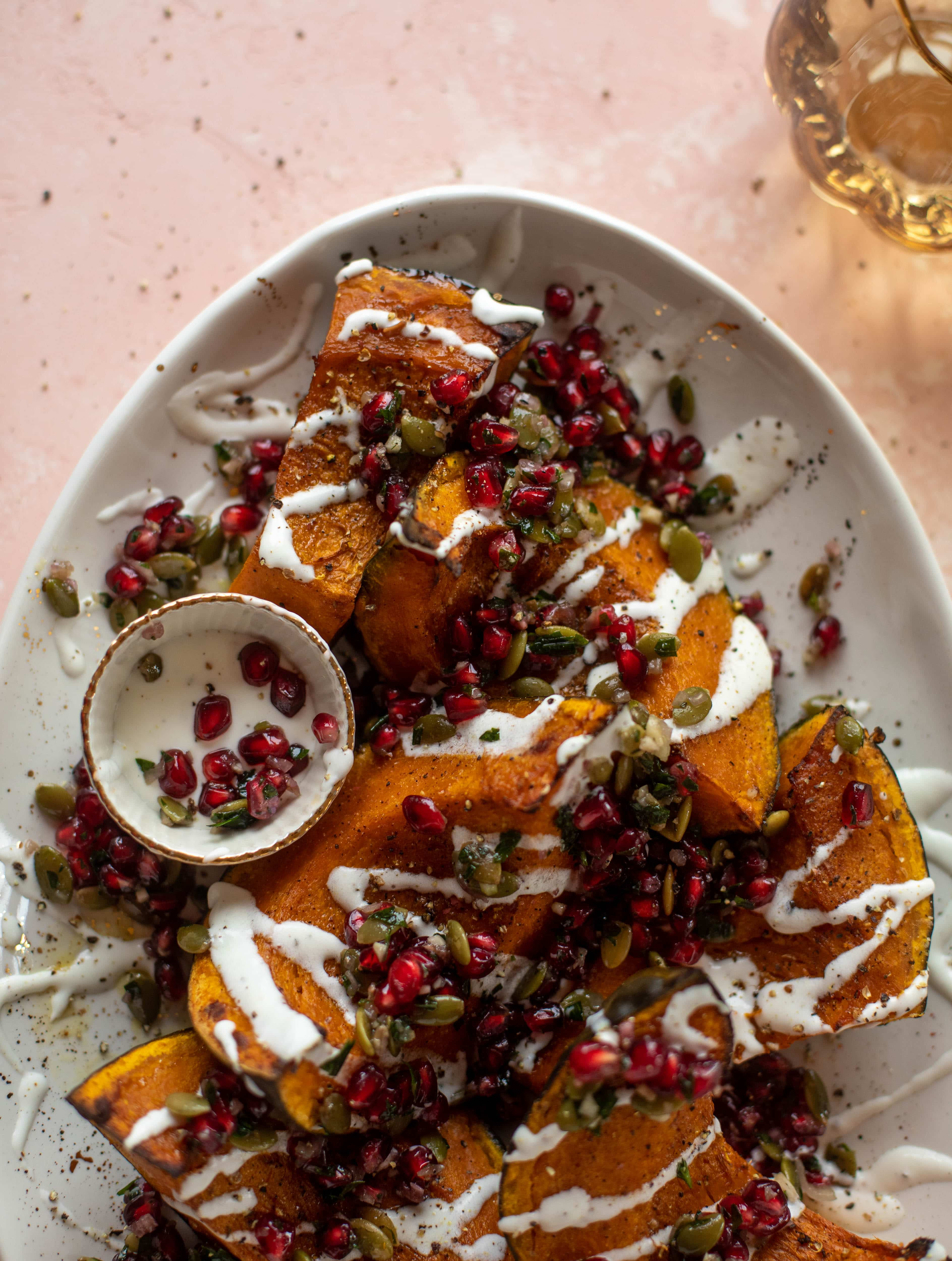 This roasted kabocha squash is caramely and naturally sweet, drizzled with whipped goat cheese and topped with pomegranate pepita relish. It's unreal!