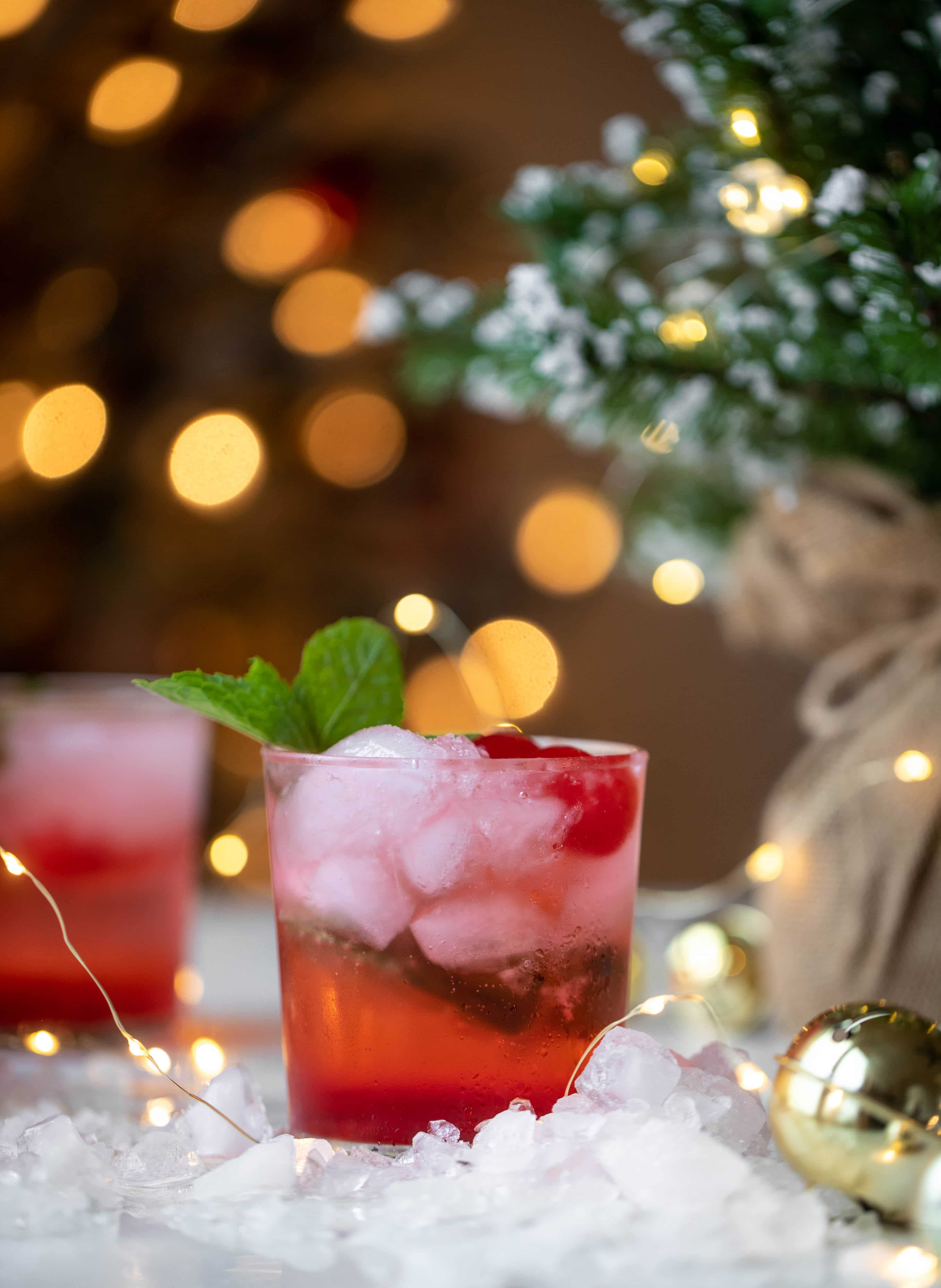 The merry cherry christmas cocktail is here! Vodka and cherries and mint, oh my! This is such a fun drink that can be made into a punch. It's delicious!
