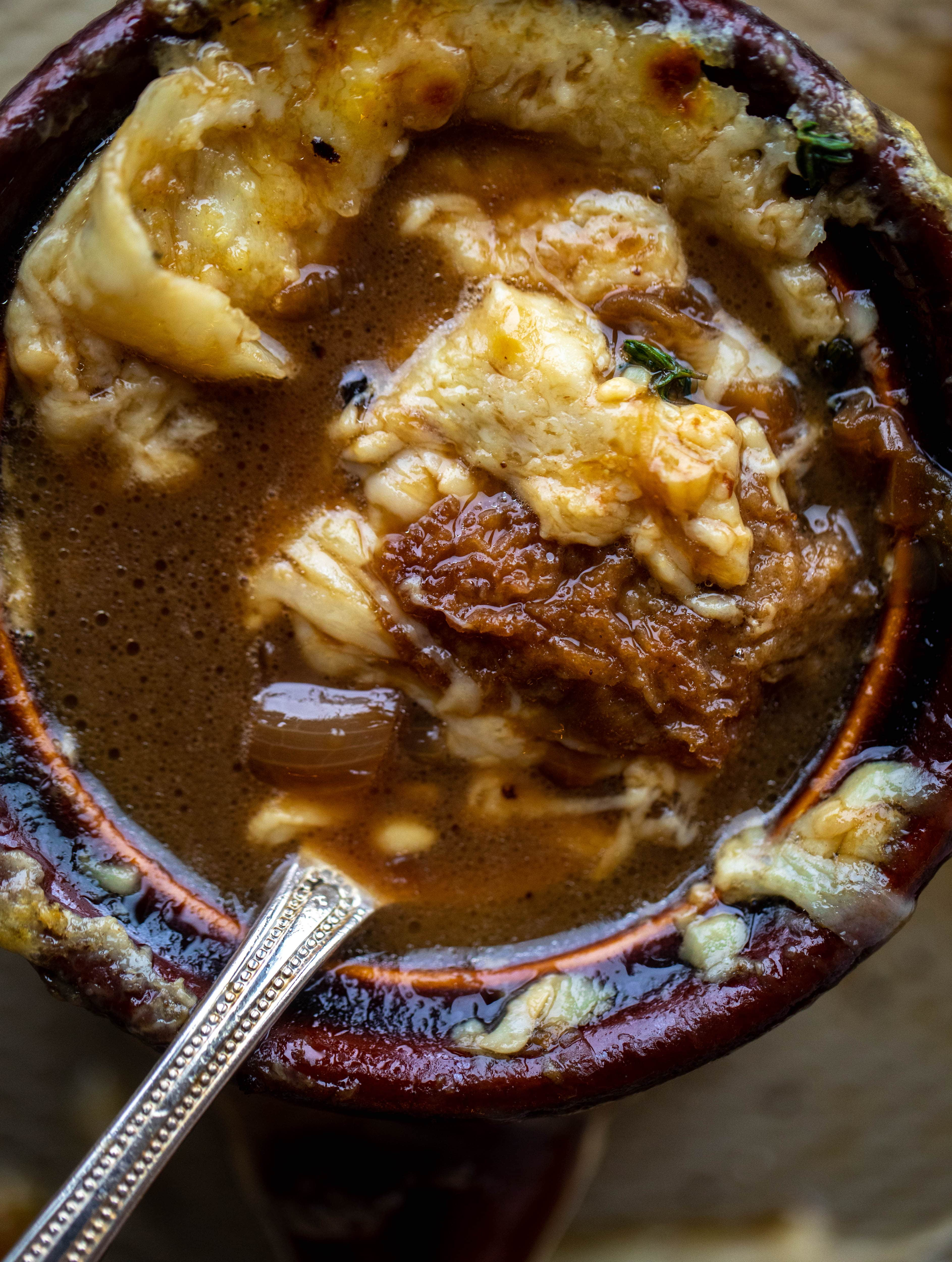 My favorite french onion soup starts with bourbon caramelized onions! Adorable heart croutons and tons of gruyere take it over the top.