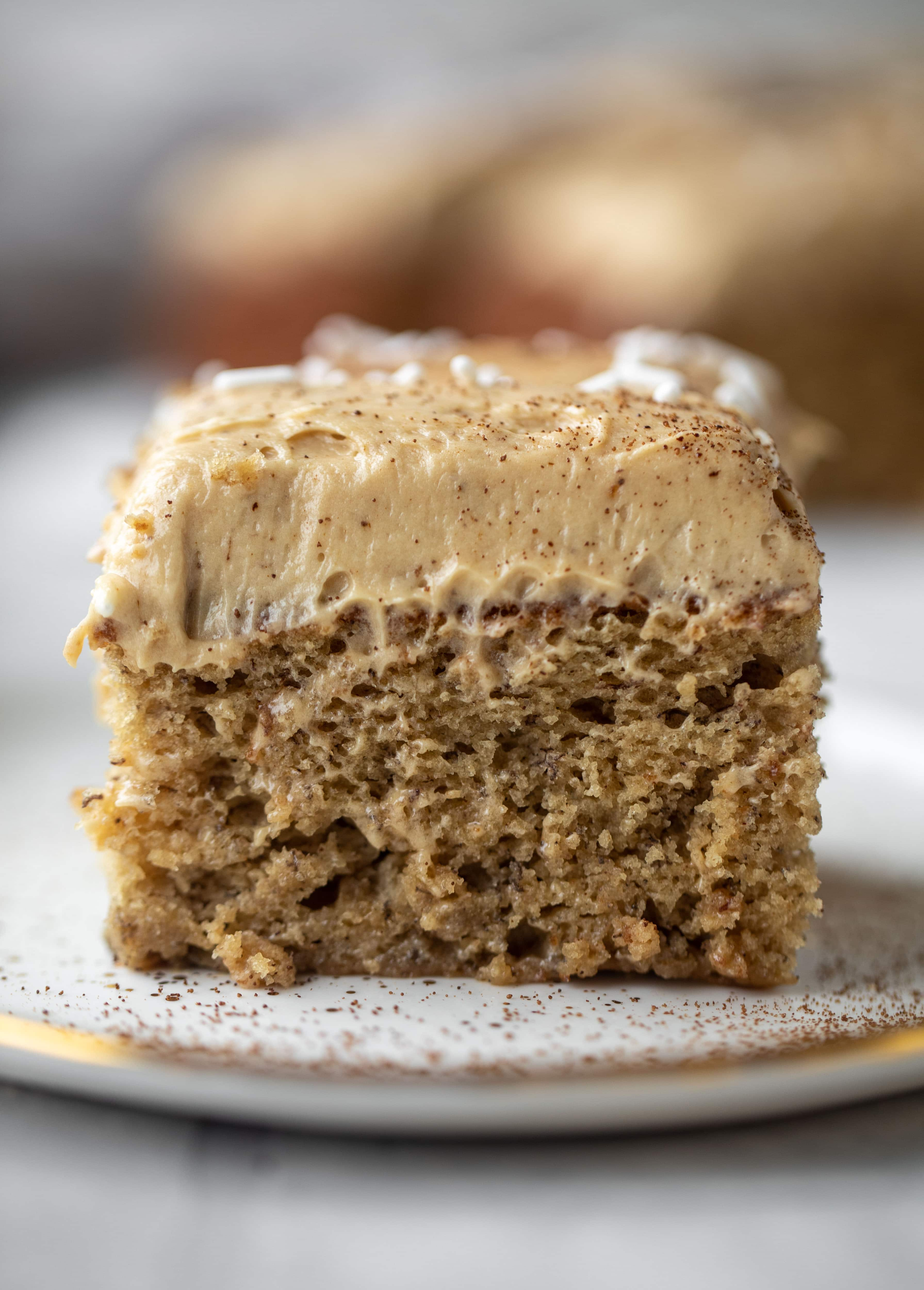 This banana cake is a delicious twist on banana bread! Covered with coffee cream cheese frosting, it's an easy and wonderful treat.
