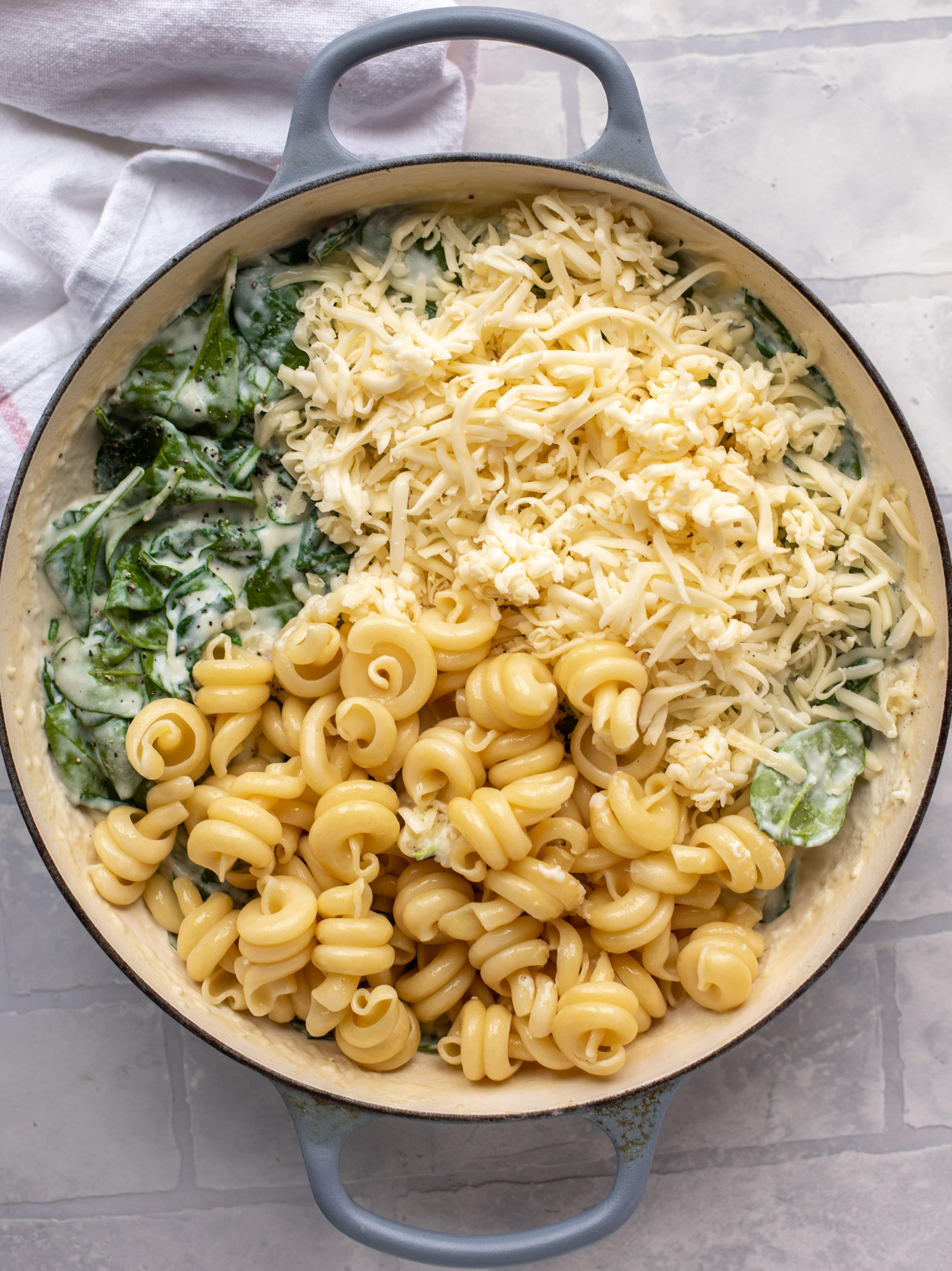 This creamed spinach mac and cheese is a dreamy, cheesy mac and cheese dish with tons of fresh baby spinach! Super comforting and flavorful.