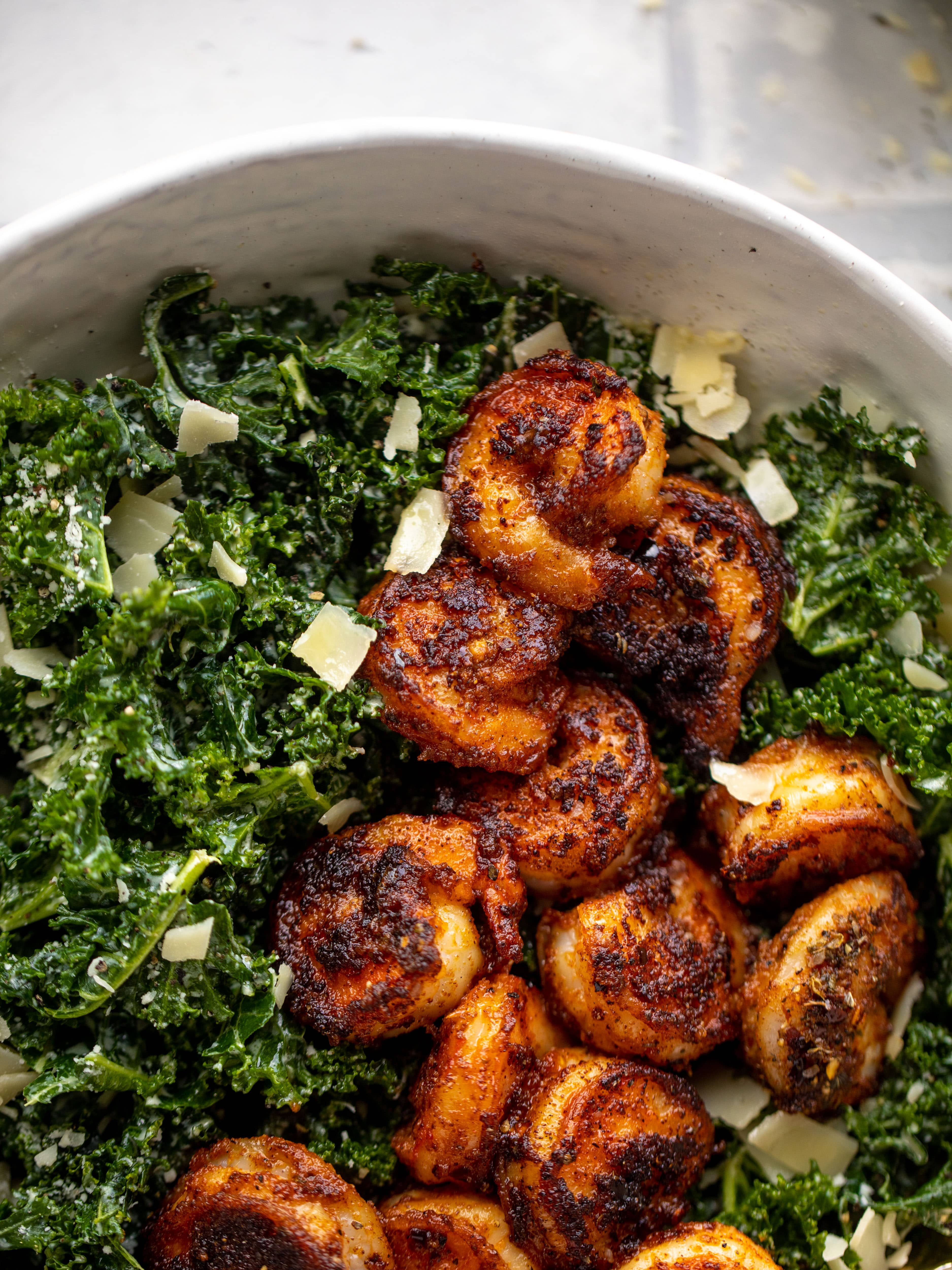 This blackened shrimp kale caesar is loaded with flavor. Spiced, buttery shrimp pan fried until golden, then thrown on kale caesar salad. Delish!