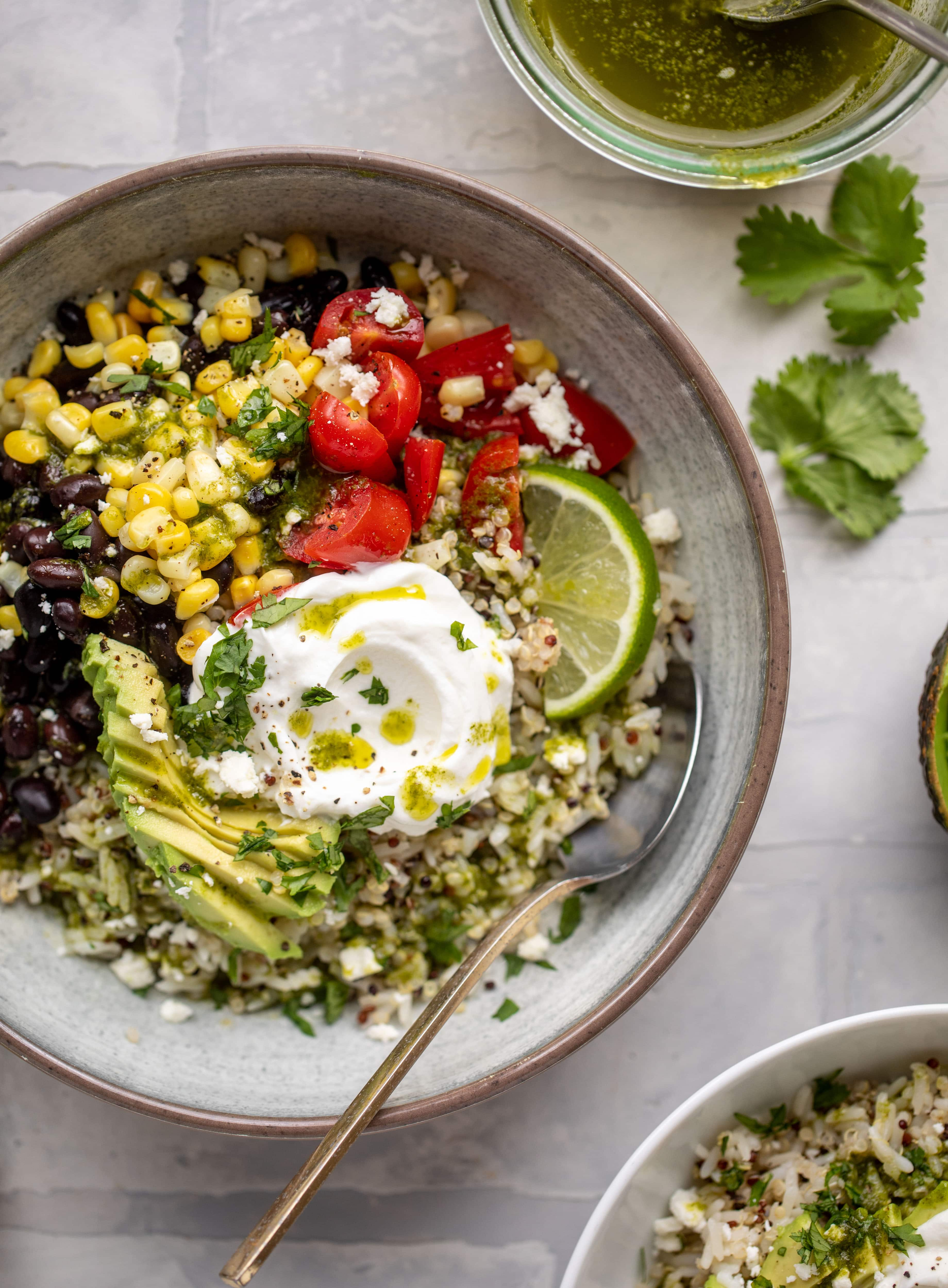 These baja grain bowls are a delicious copycat of the Panera baja grain bowls! Rice, quinoa, beans, tomatoes and cilantro lime vinaigrette!