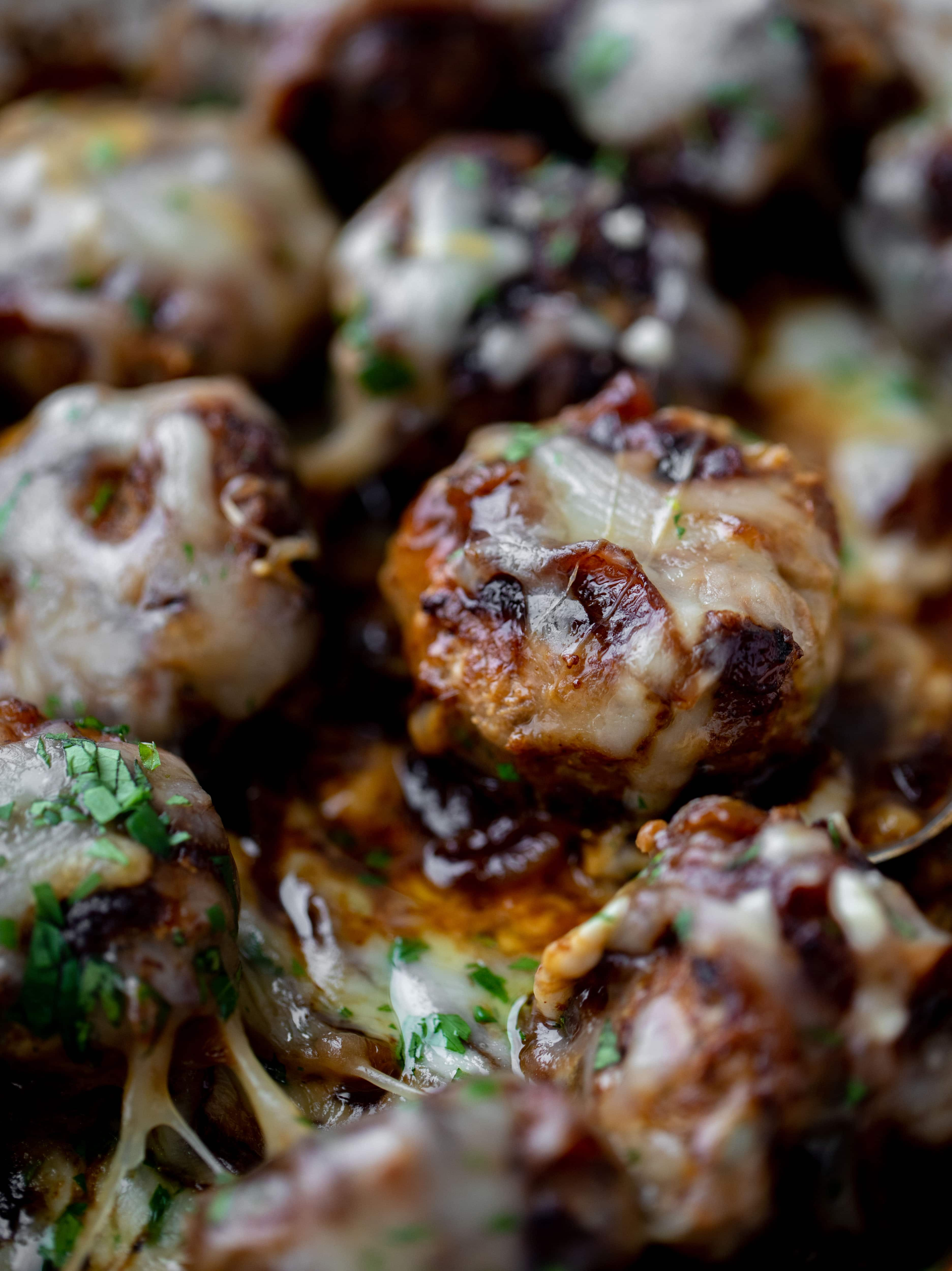 These french onion meatballs are super delicious! All the flavors of french onion soup made into juicy meatballs. Cheesy, saucy goodness!