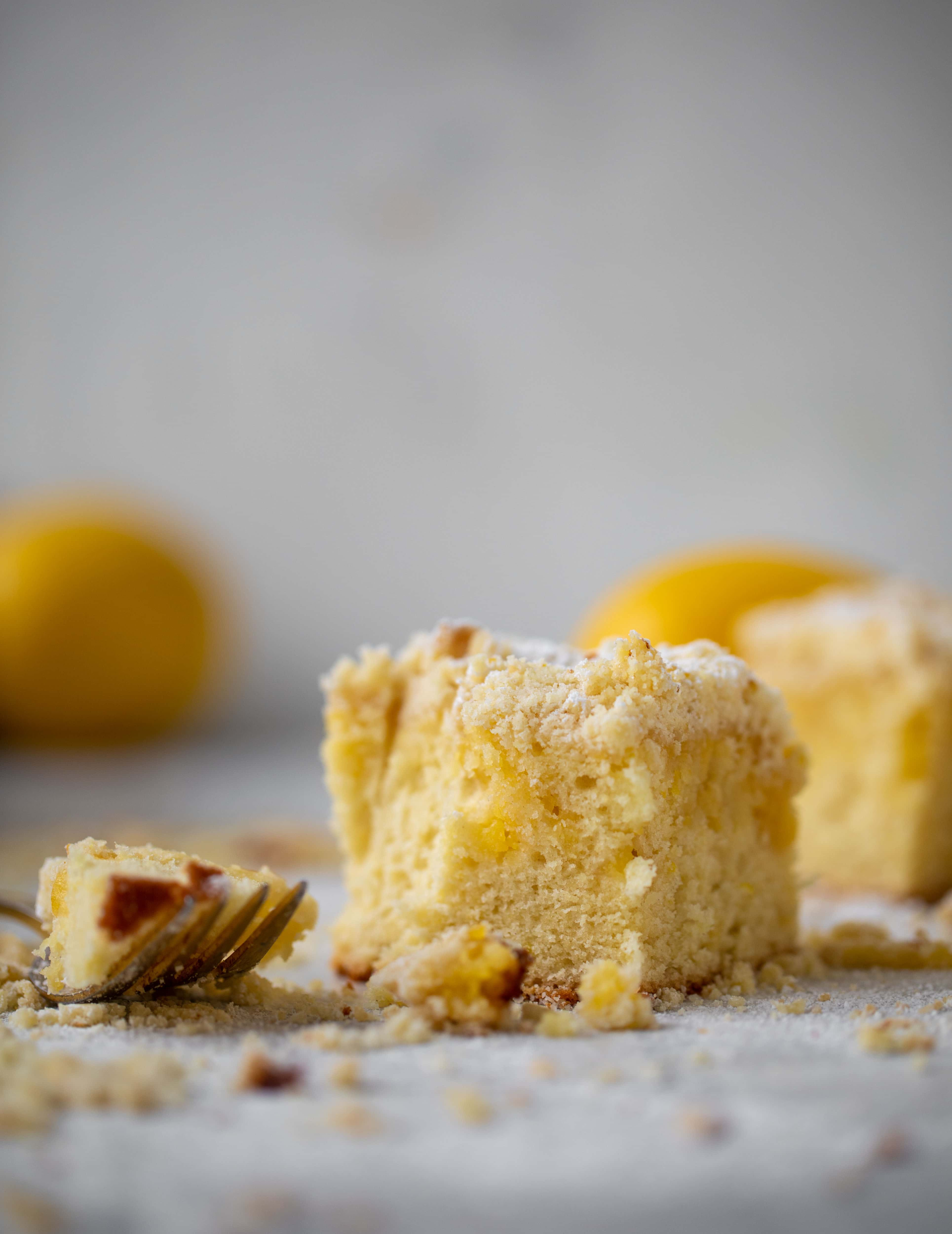 This lemon crumb cake is incredible! Lemon cake, lemon curd and lemon crumb come together for this delicious breakfast or dessert bite!