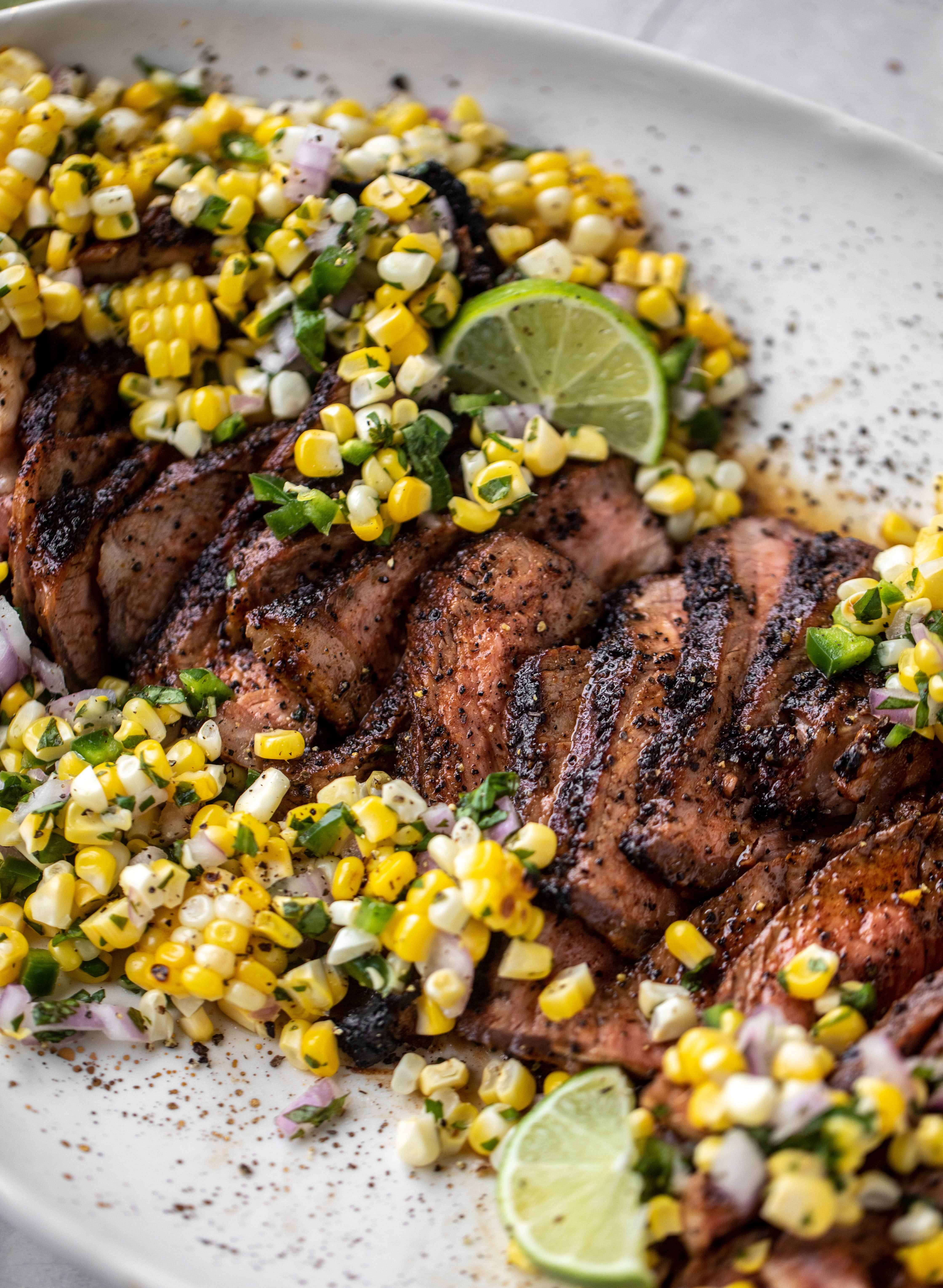 This coffee crusted steak is incredibly flavorful! Topped with a fresh and bright herbed corn salsa, it's the perfect meal to kick off summer.