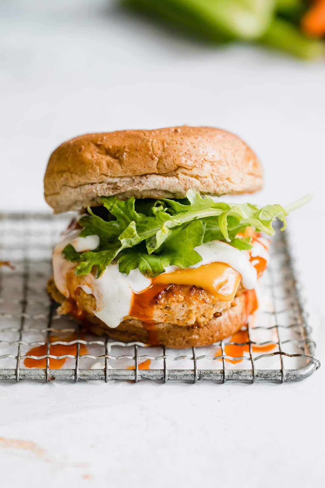 buffalo chicken burgers I howsweeteats.com #buffalo #chicken #burgers