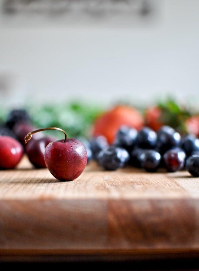 Triple Berry Kale Salad with Fresh Strawberry Vinaigrette I howsweeteats.com