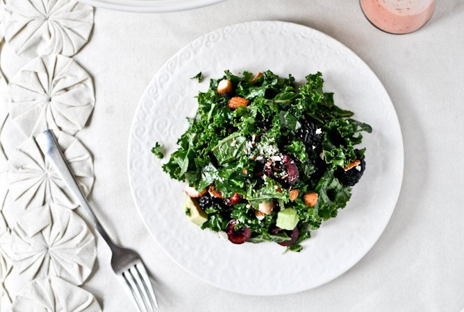Triple Berry Kale Salad with Fresh Strawberry Vinaigrette I howsweeteats.com